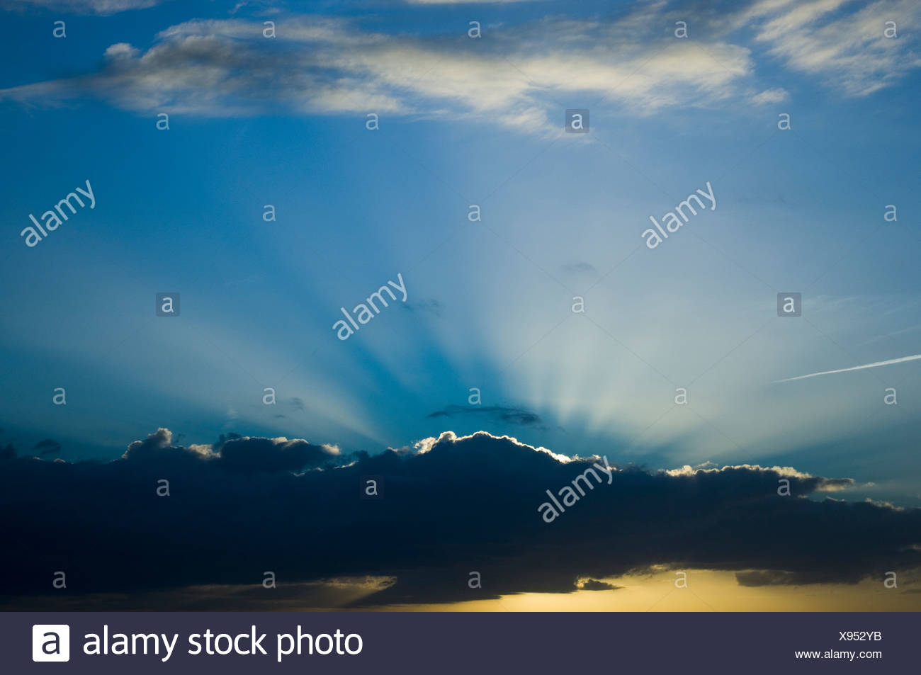 Sunrise behind clouds - Stock Image