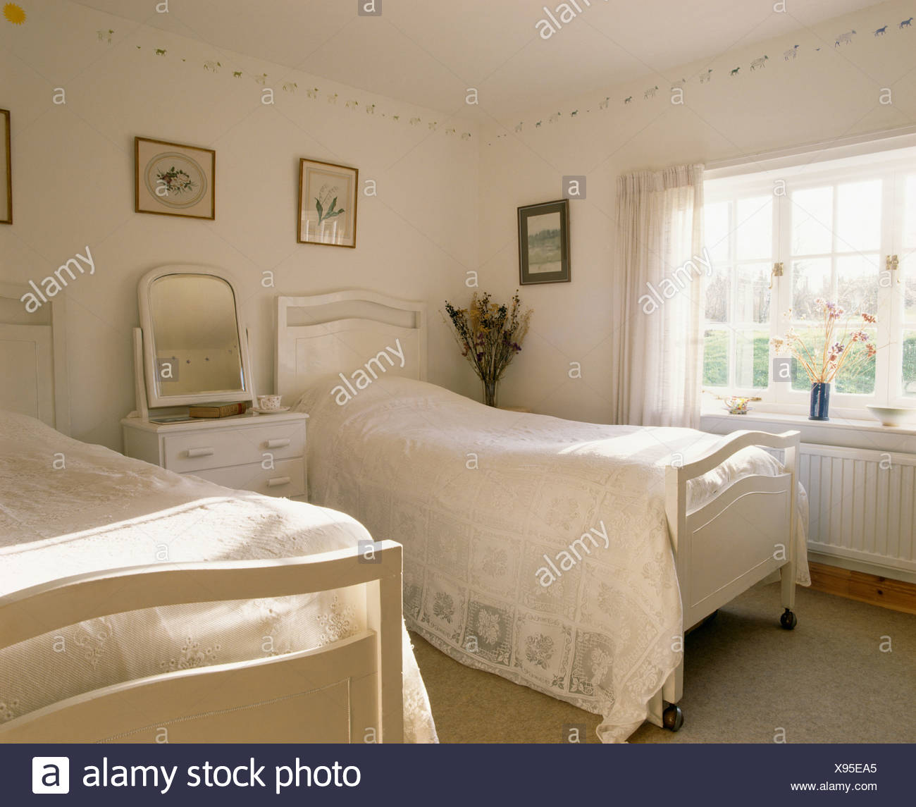 White Twin Beds With White Bed Covers In Traditional White Bedroom