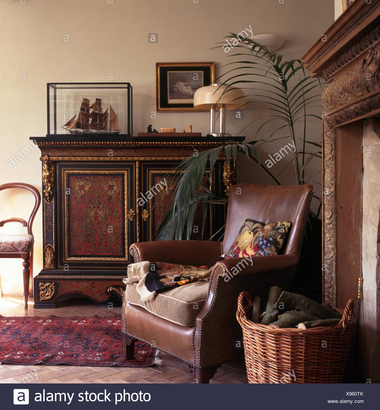 Charming Brown Leather Chair And Ornate Antique Cupboard In Old Fashioned Living Room