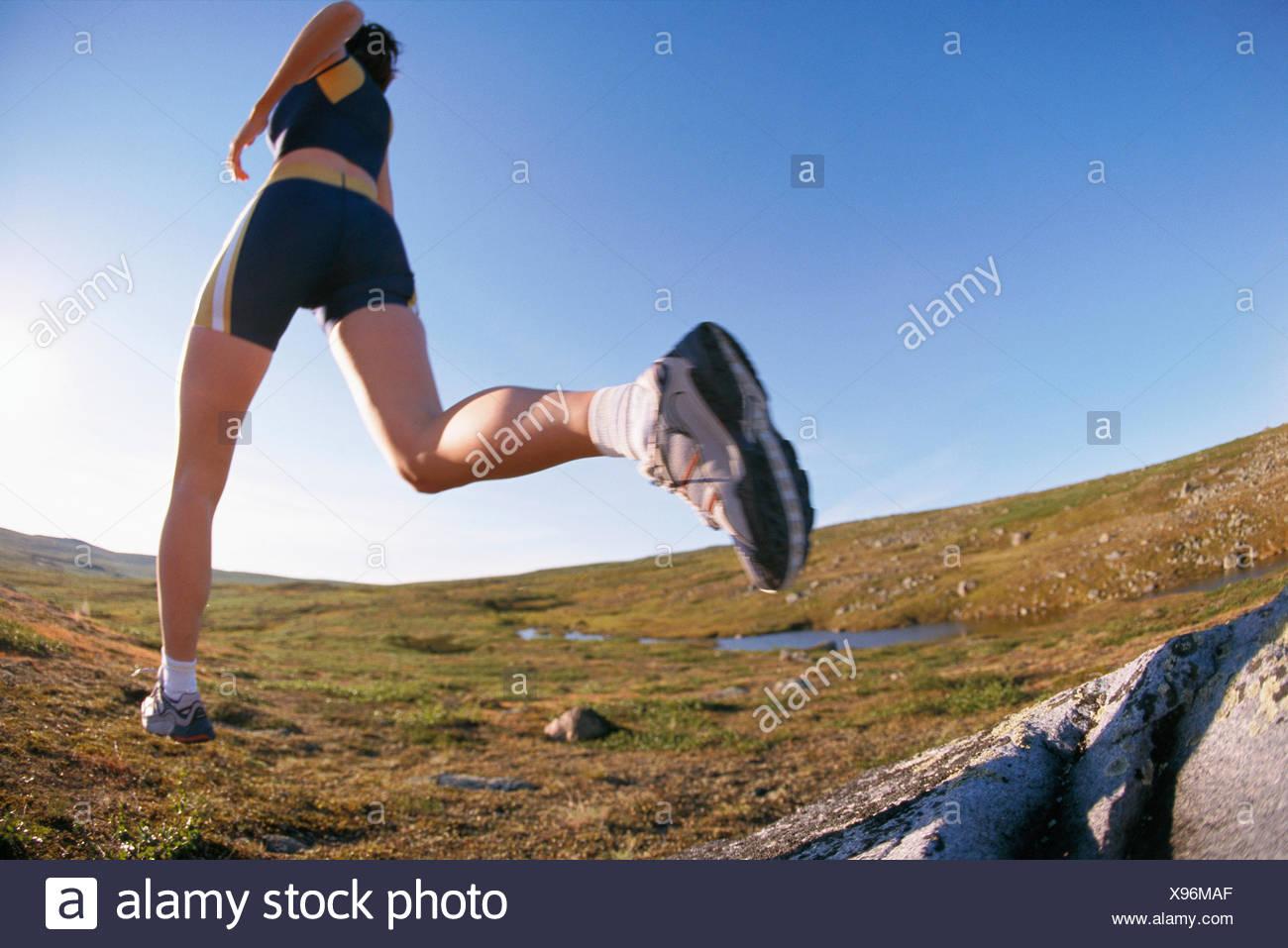 A female jogger. - Stock Image