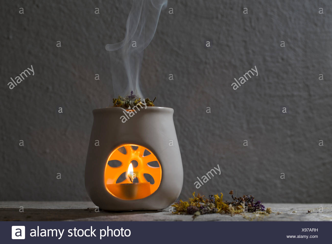 burning incense with herbs, aroma lamp - Stock Image