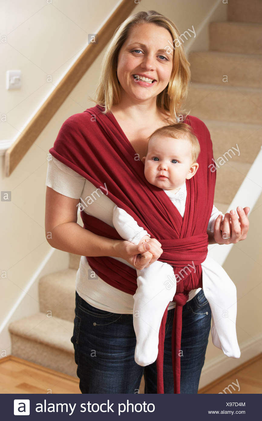 Baby In Sling With Mother - Stock Image