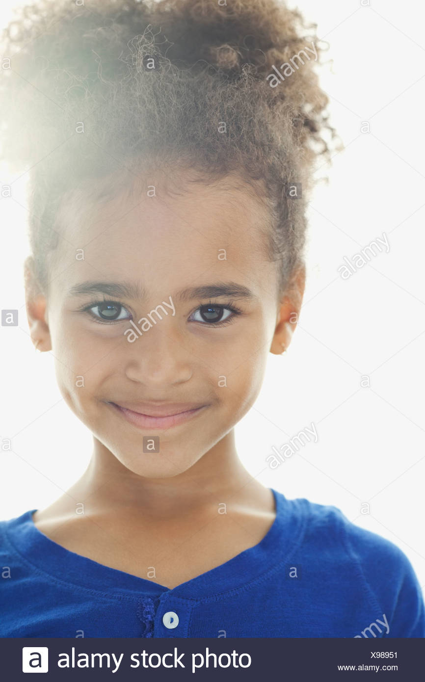 Close-up portrait of cute girl smiling - Stock Image