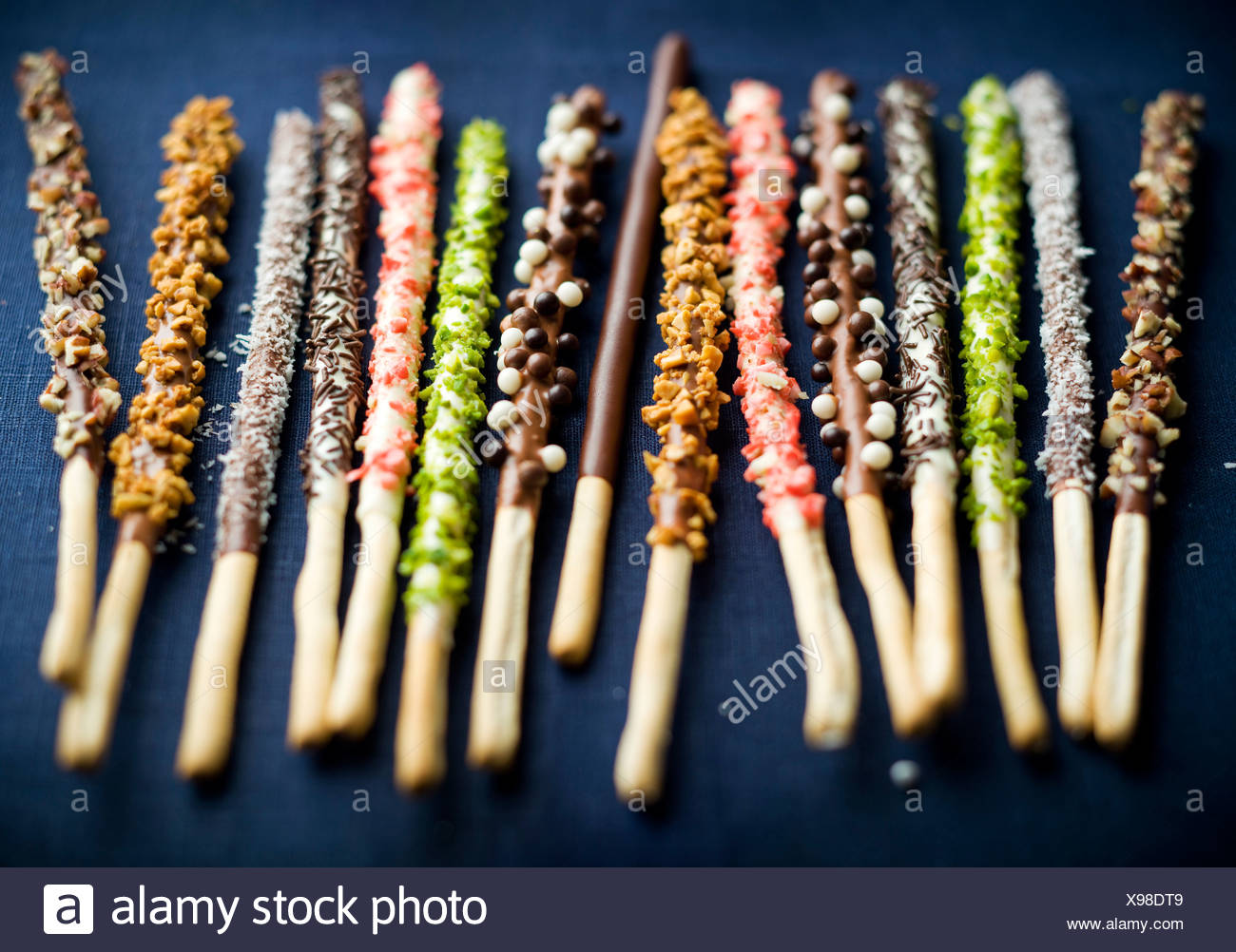 Different flavored chocolate Mikados - Stock Image