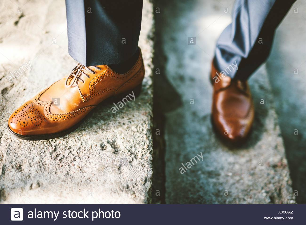 Low Section Of Man With Brogue Shoes Standing On Steps - Stock Image