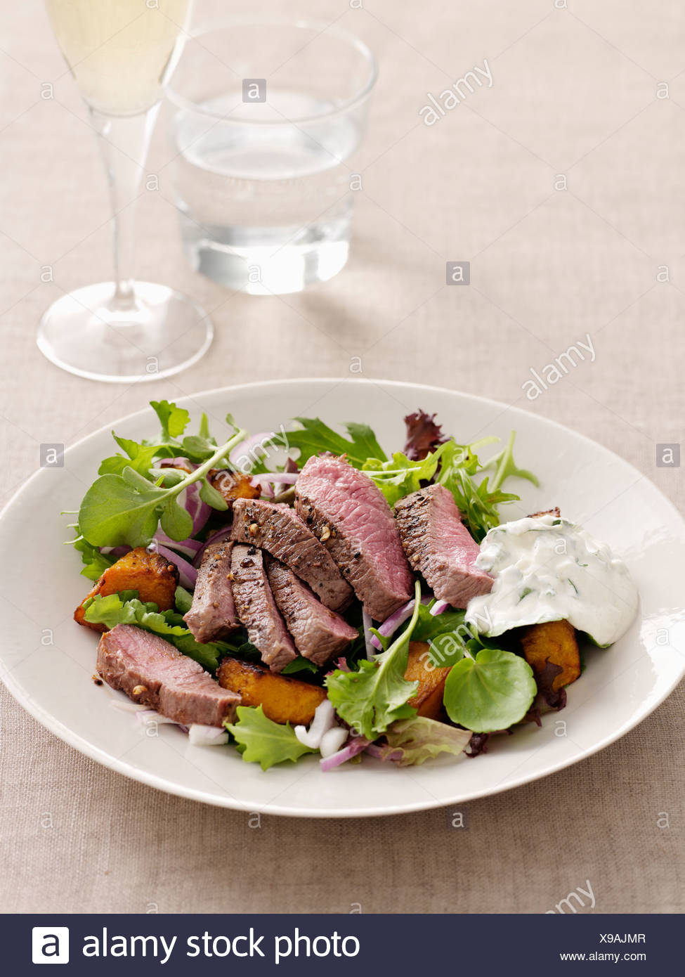 Plate of meat with vegetables - Stock Image