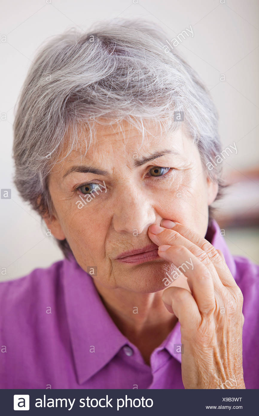 ELDERLY PERSON WITH A TOOTHACHE - Stock Image
