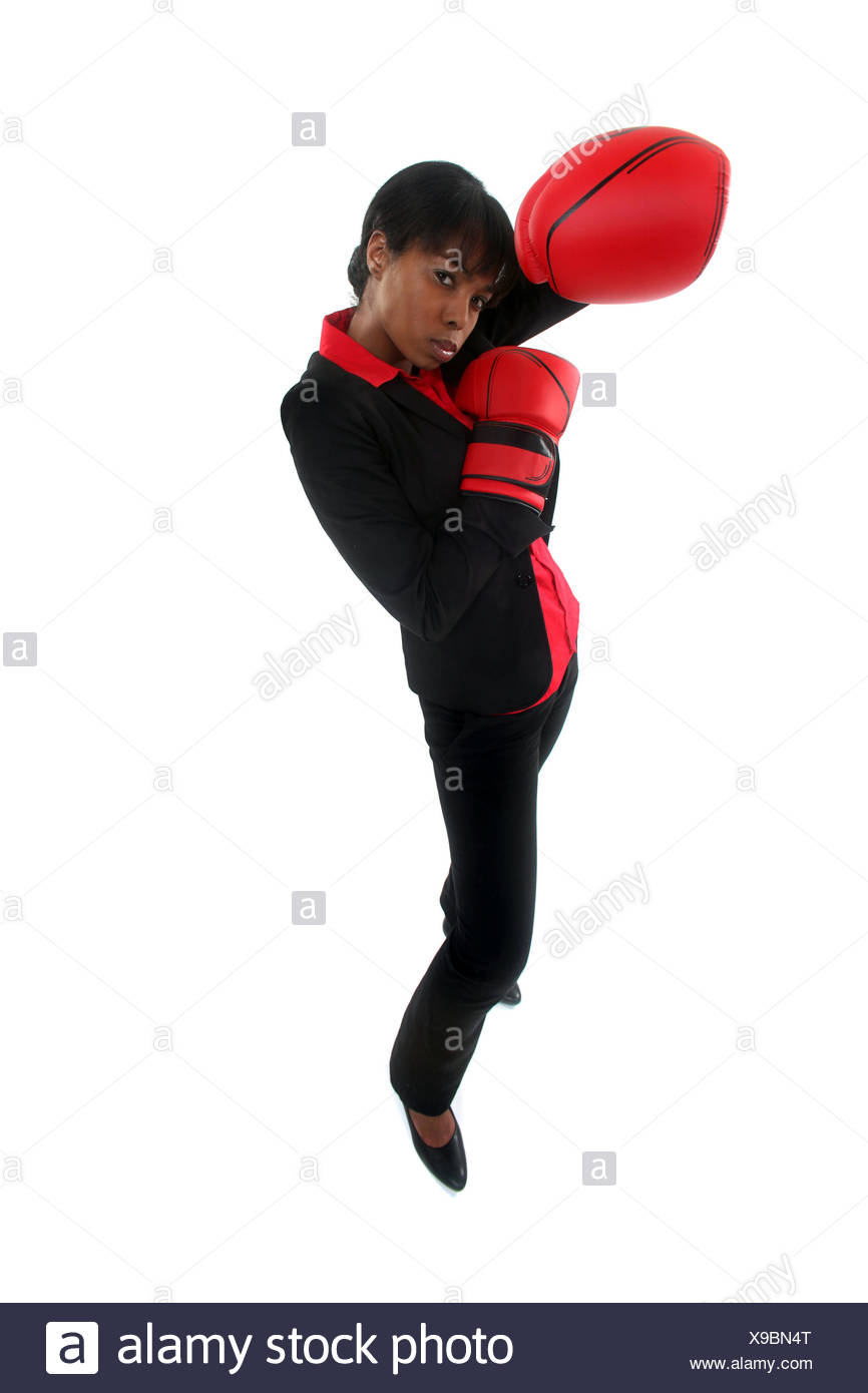 A businesswoman in a fighting stance. - Stock Image