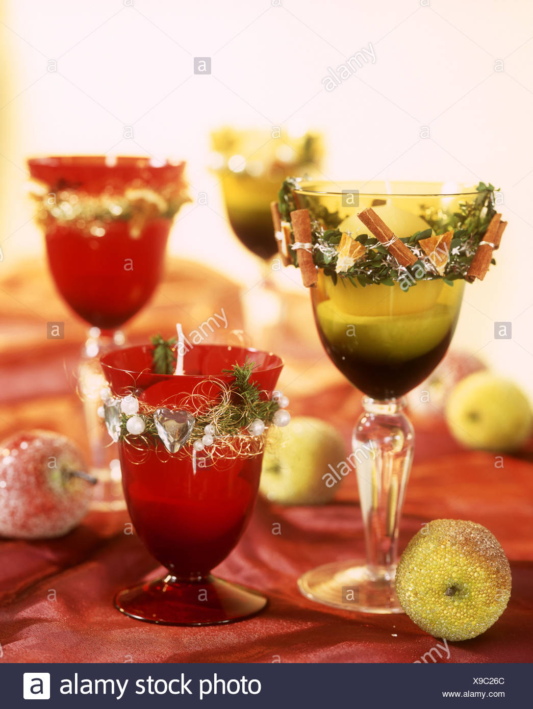 decorated glasses as christmas candle holders