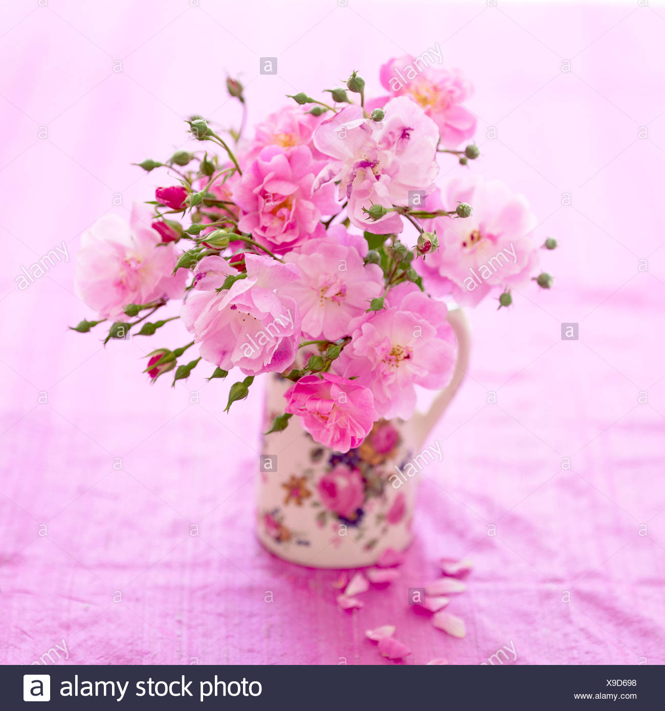 A bunch of pink roses in a jug - Stock Image
