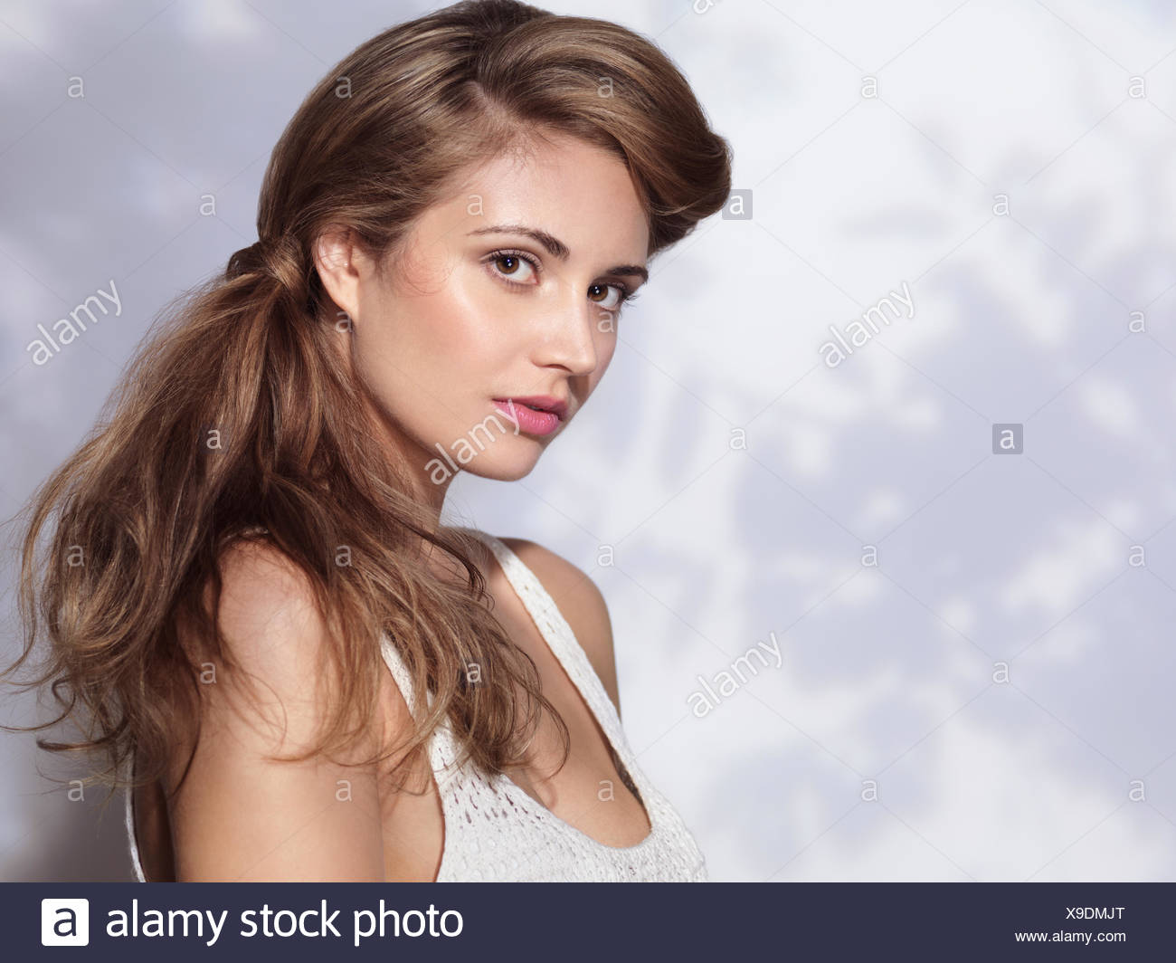 Young Woman With Natural Makeup And Classic Hairstyle Stock Photo