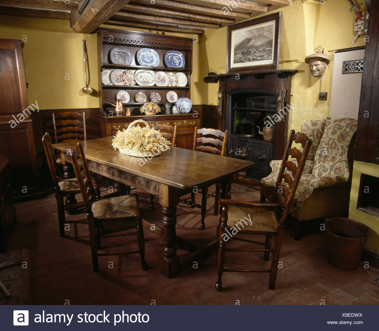 Attirant Antique Table And Rush Seated Chairs In Pale Yellow Country Diningroom With  Fireplace And Beamed Ceiling