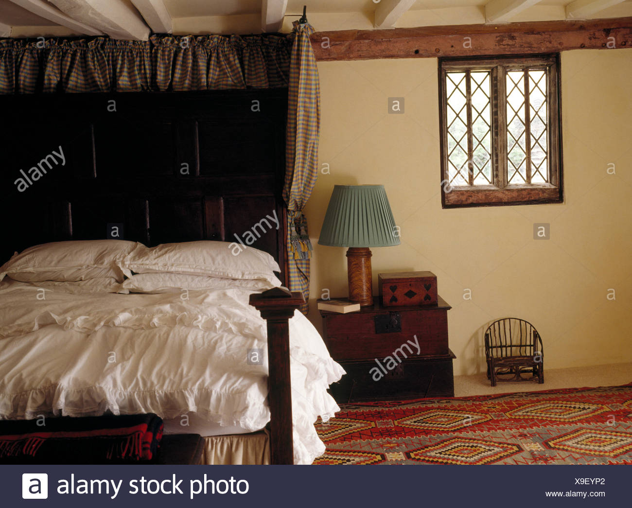 Antique Half Tester Oak Bed In An Old Fashioned Bedroom With A
