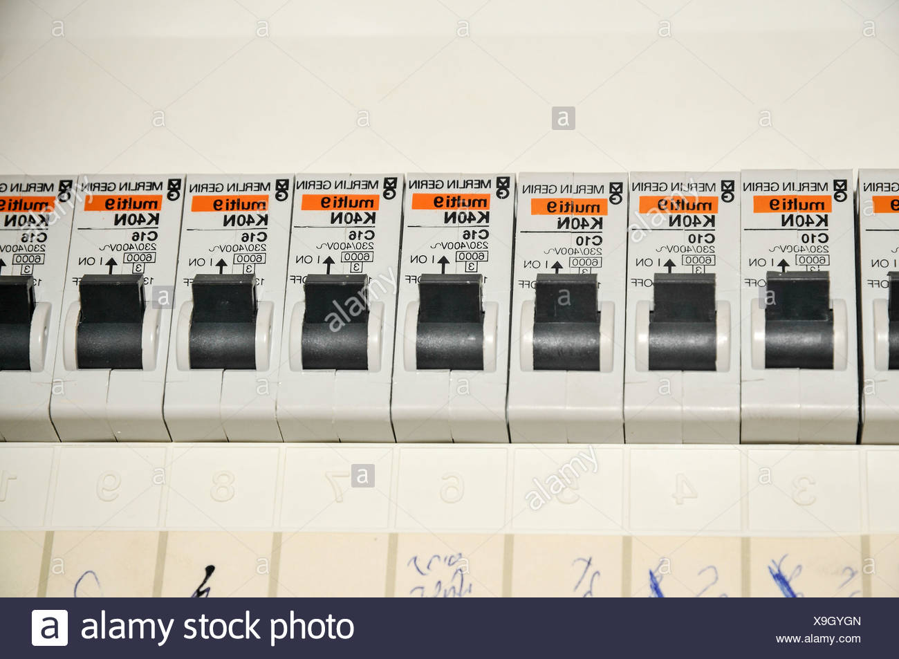 Domestic fuse box close up with trip switches circuit breakers - Stock Image