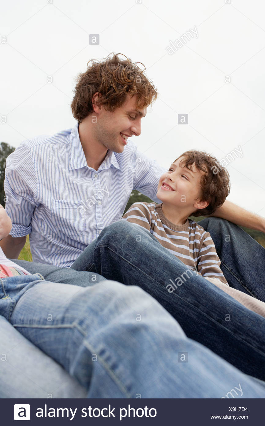Father and son in a field - Stock Image