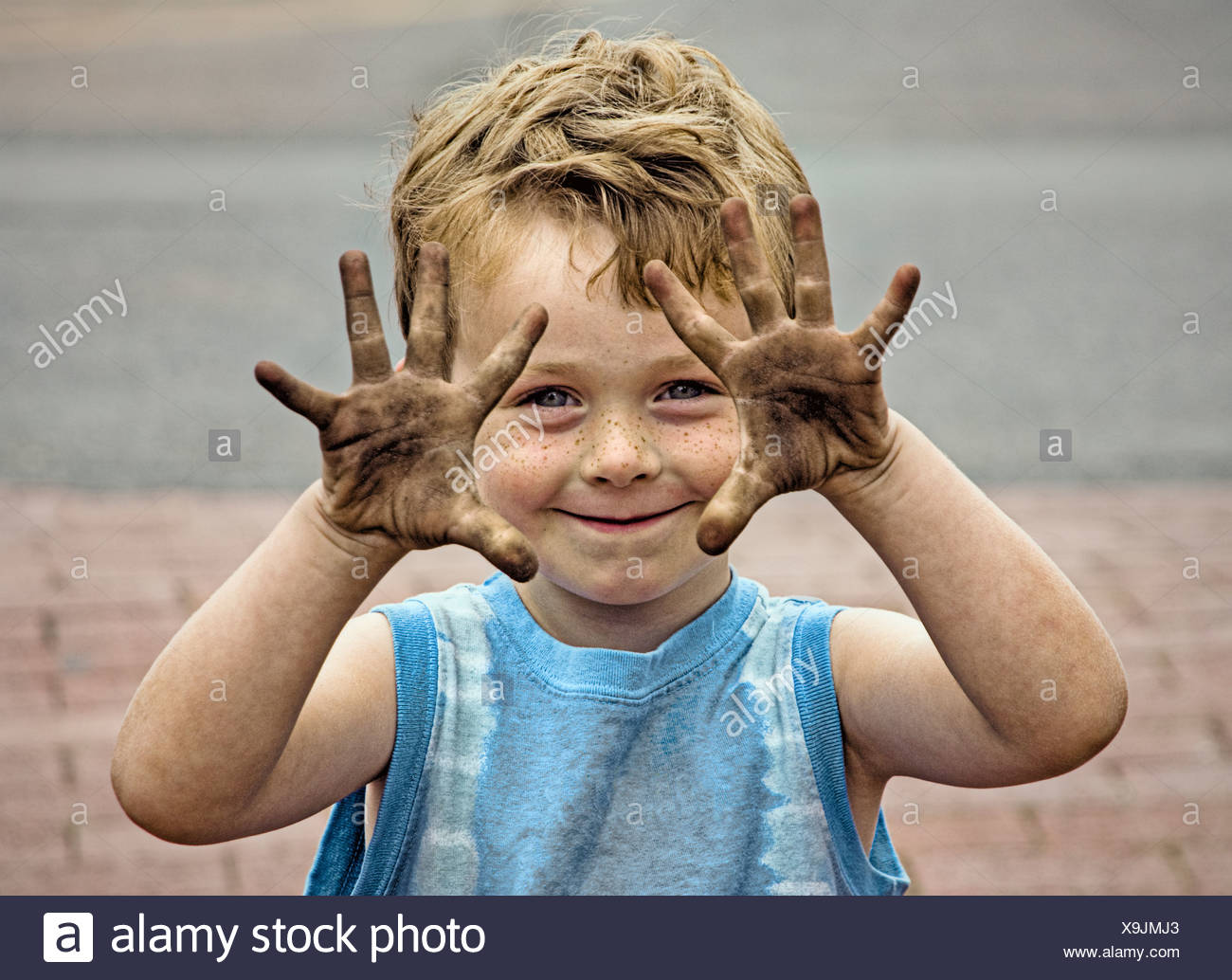 Boy with dirty hands. - Stock Image