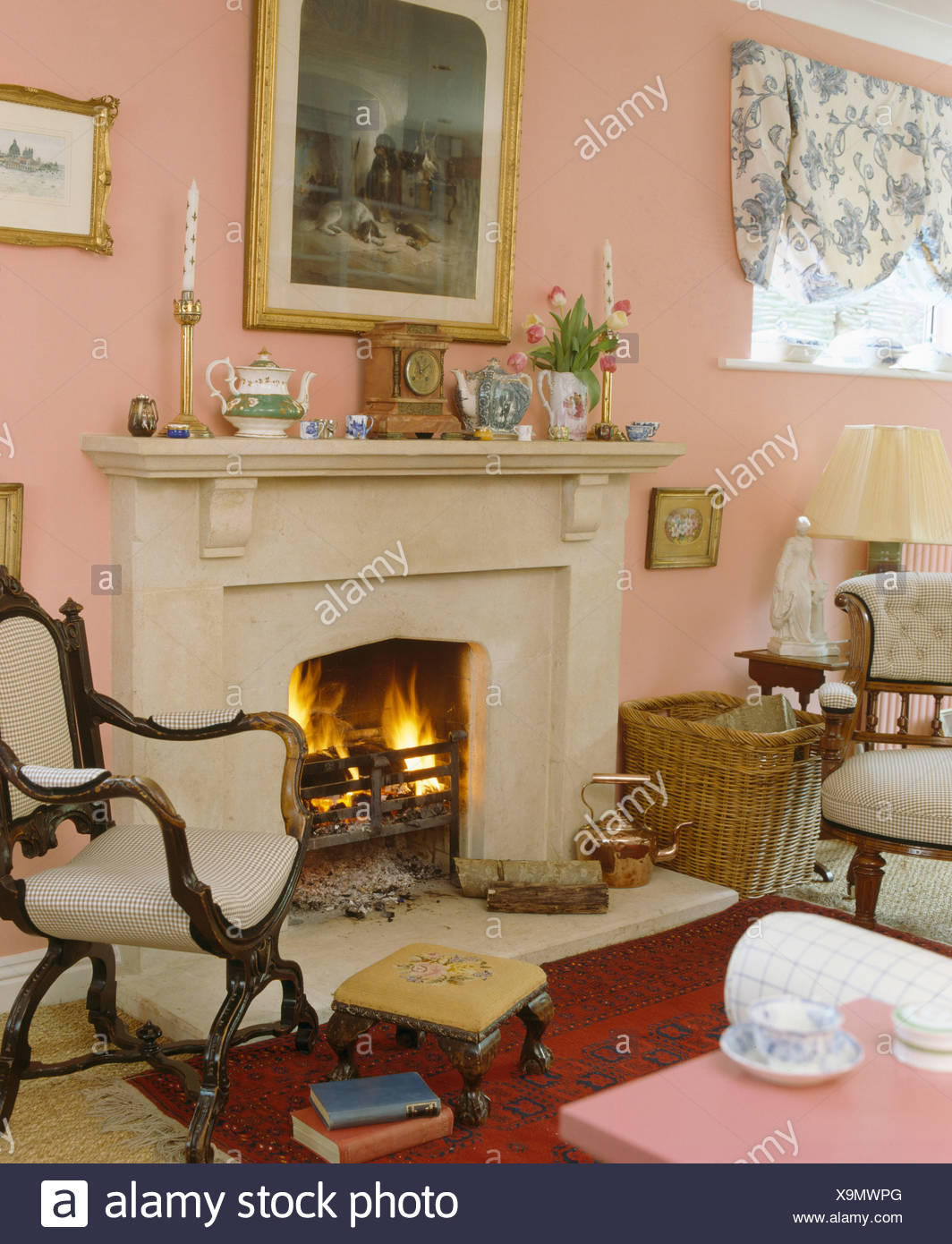 Ordinaire Picture On Wall Above Fireplace With Lighted Fire In Peach Living Room With  Cream Upholstered Antique Chairs