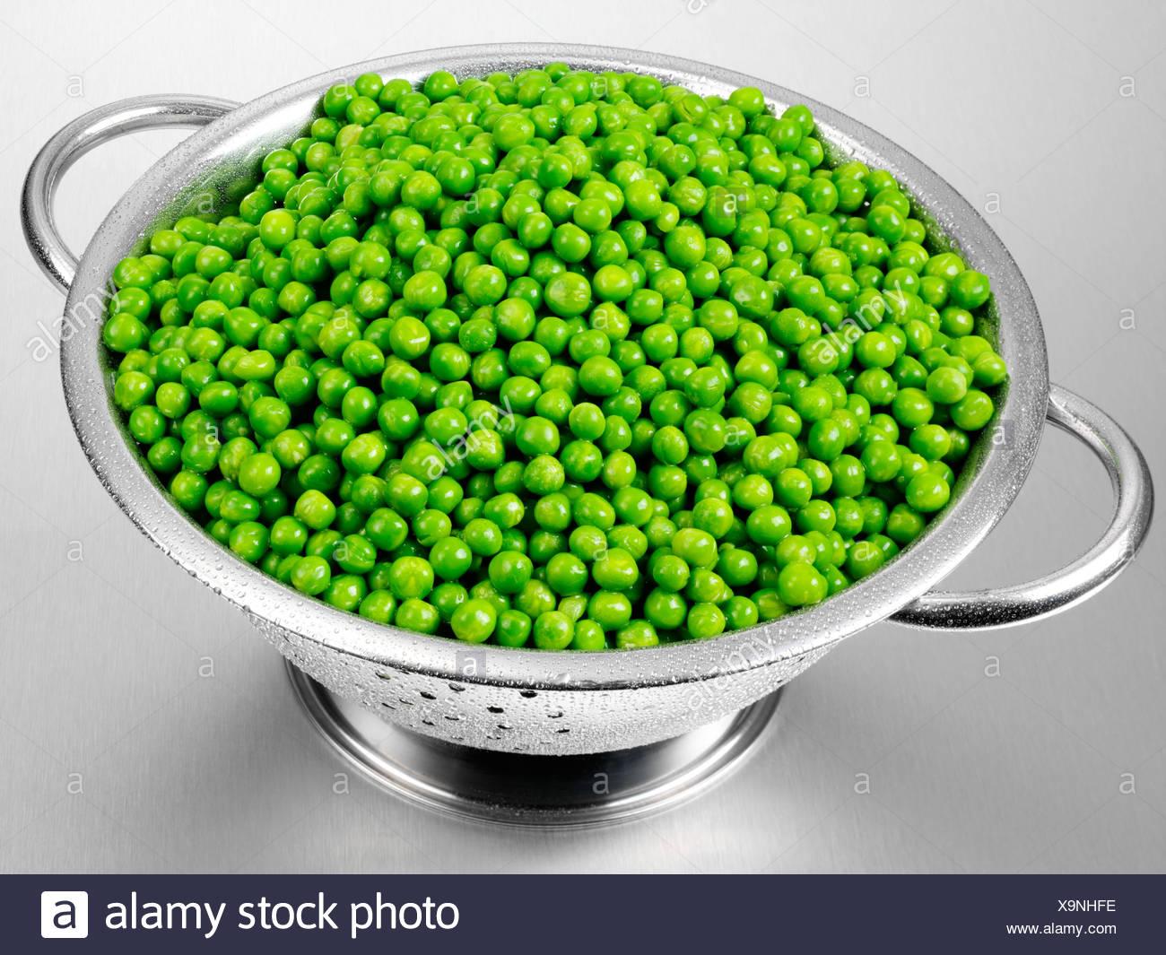 fresh garden peas in colander - Garden Peas