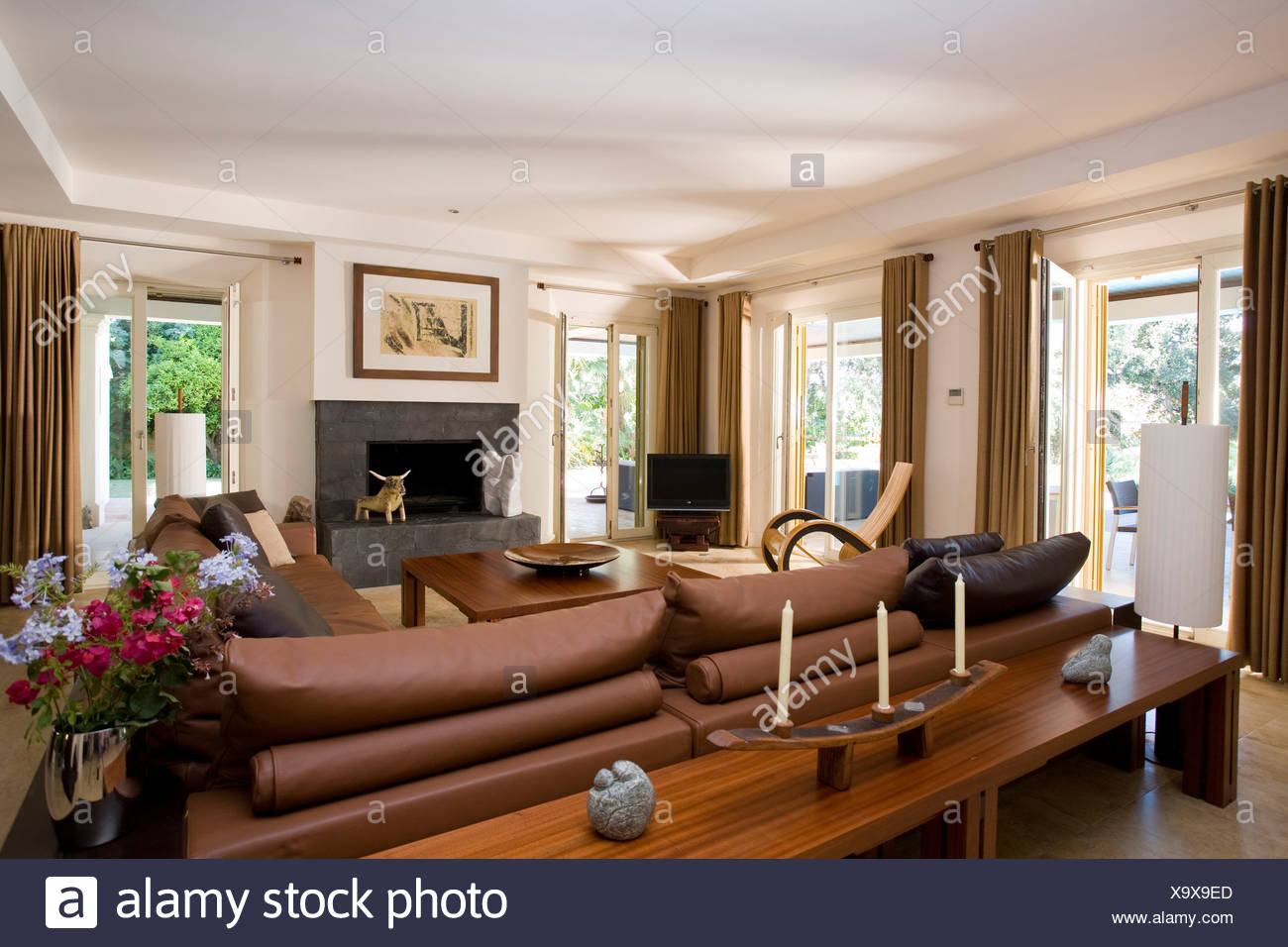 Brown and cream colour scheme with slate fireplace make for a ...
