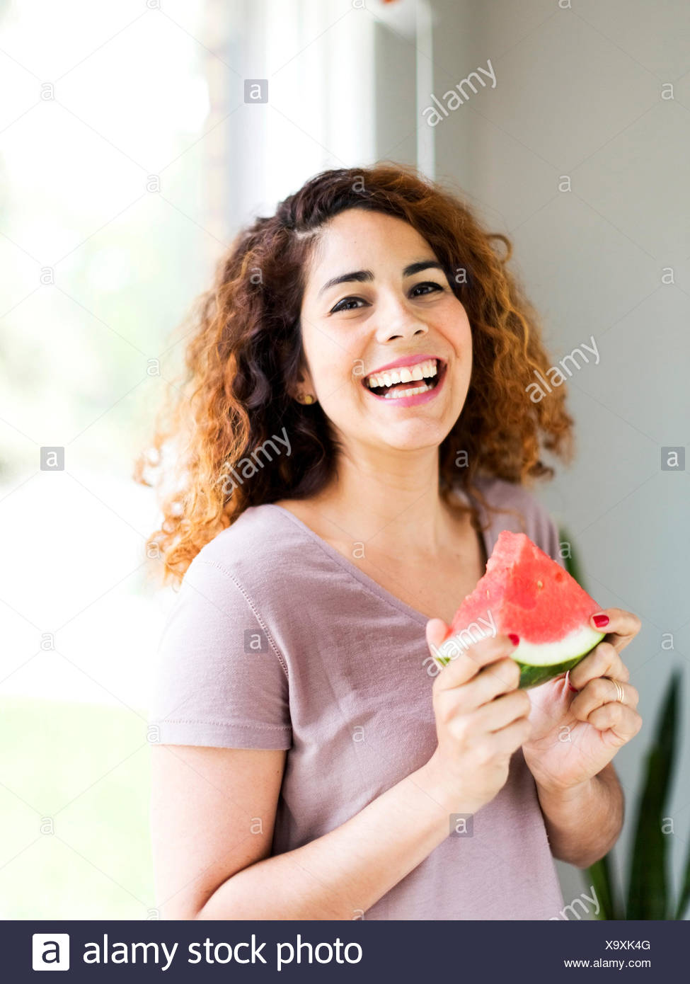 Woman holding water melon - Stock Image