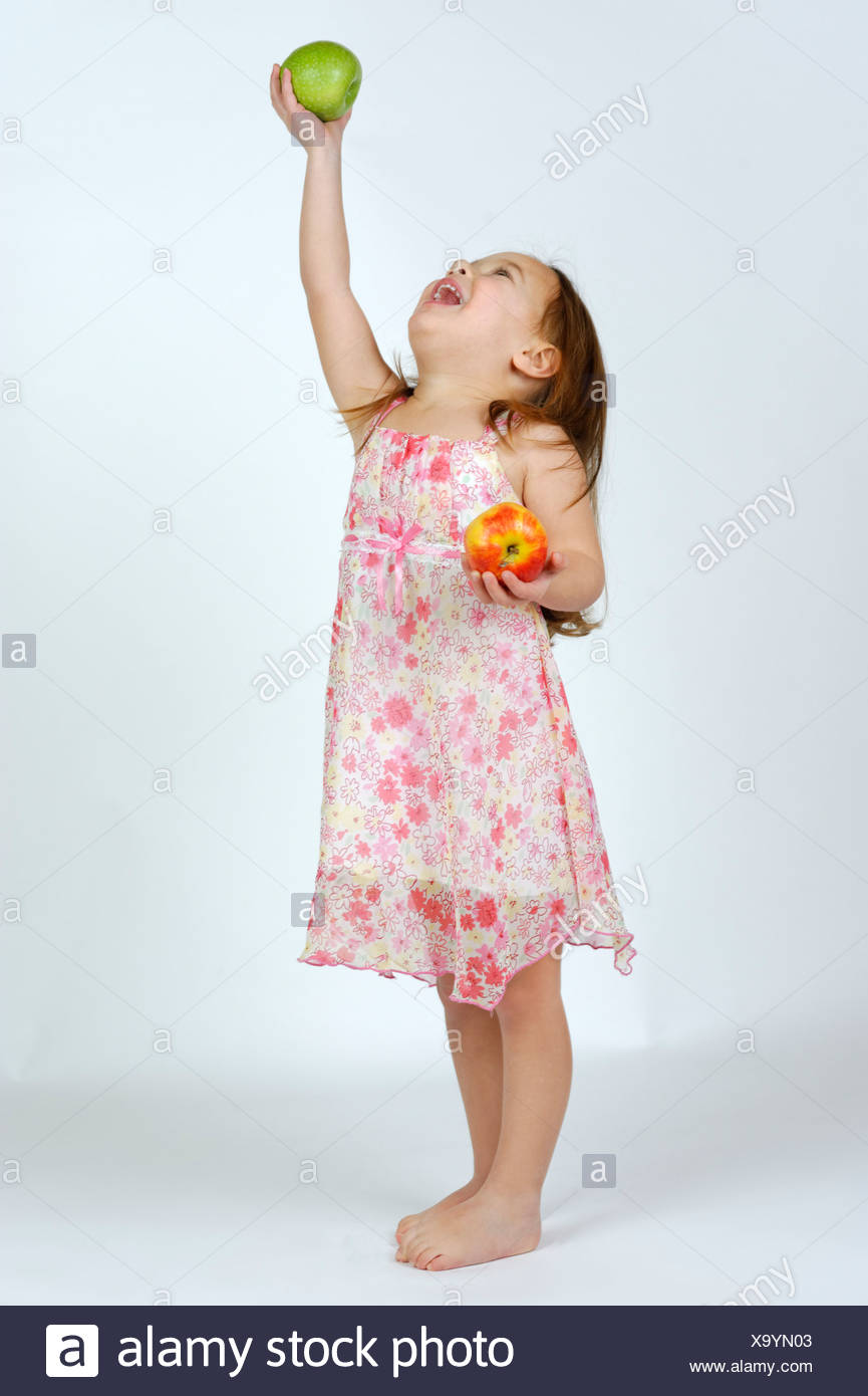 bcbf6e94d0b Girl with a red and a green apple Stock Photo  281506963 - Alamy
