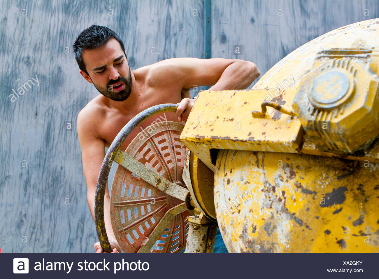 Construction Worker Working On A Cement Mixture - Stock Image