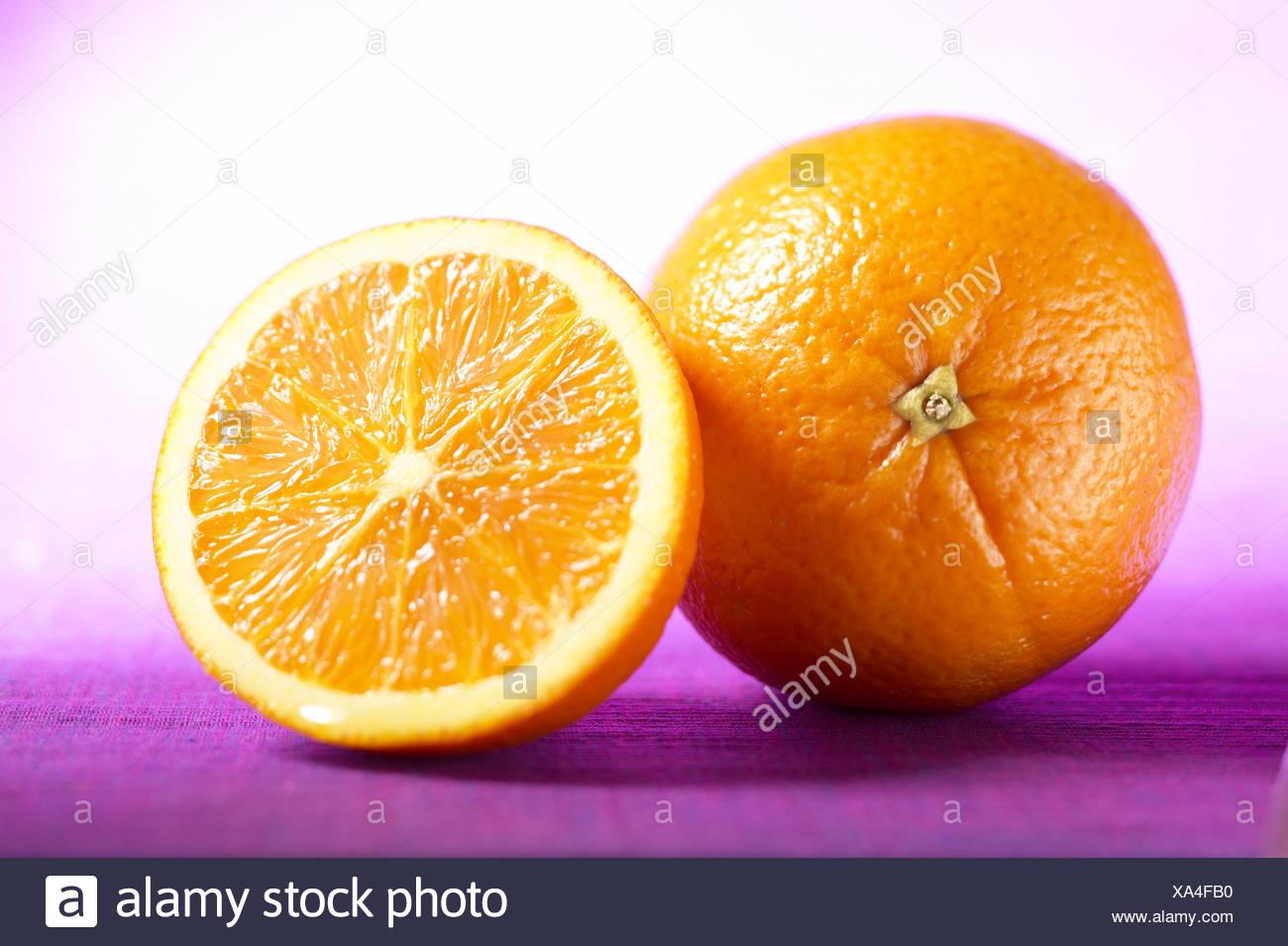 Whole and half and orange - Stock Image
