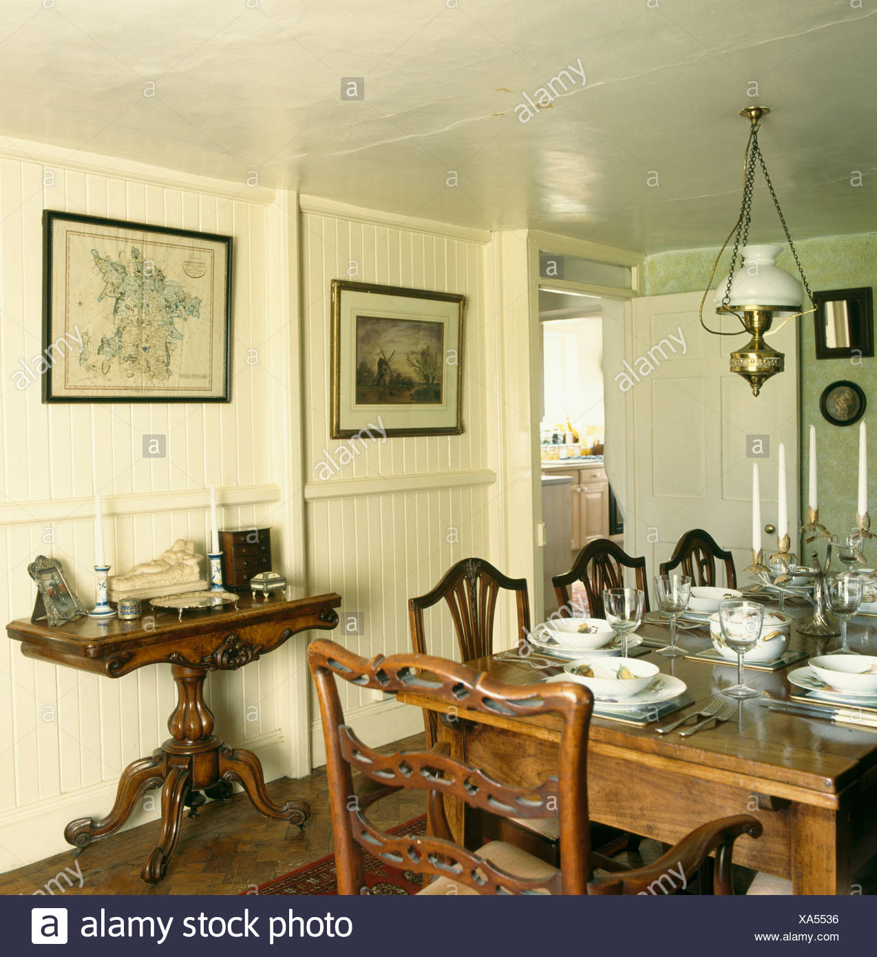 Antique Table And Chairs In Neutral Dining Room With Console Table And  Panelled Cream Walls