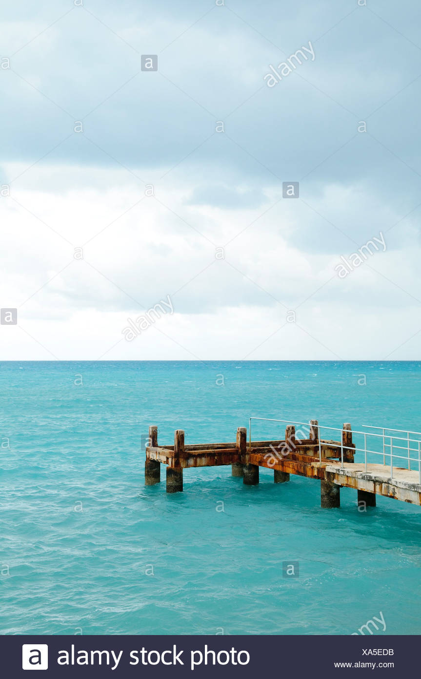 Lone pier on a stormy day, St. George's Parish, Bermuda - Stock Image