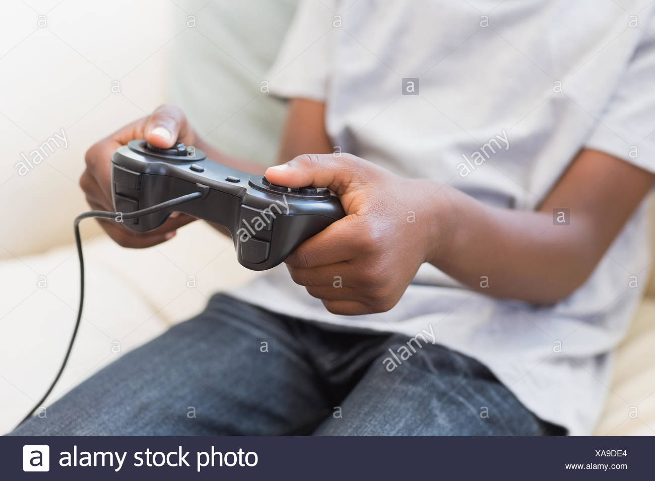 Little boy playing video games - Stock Image
