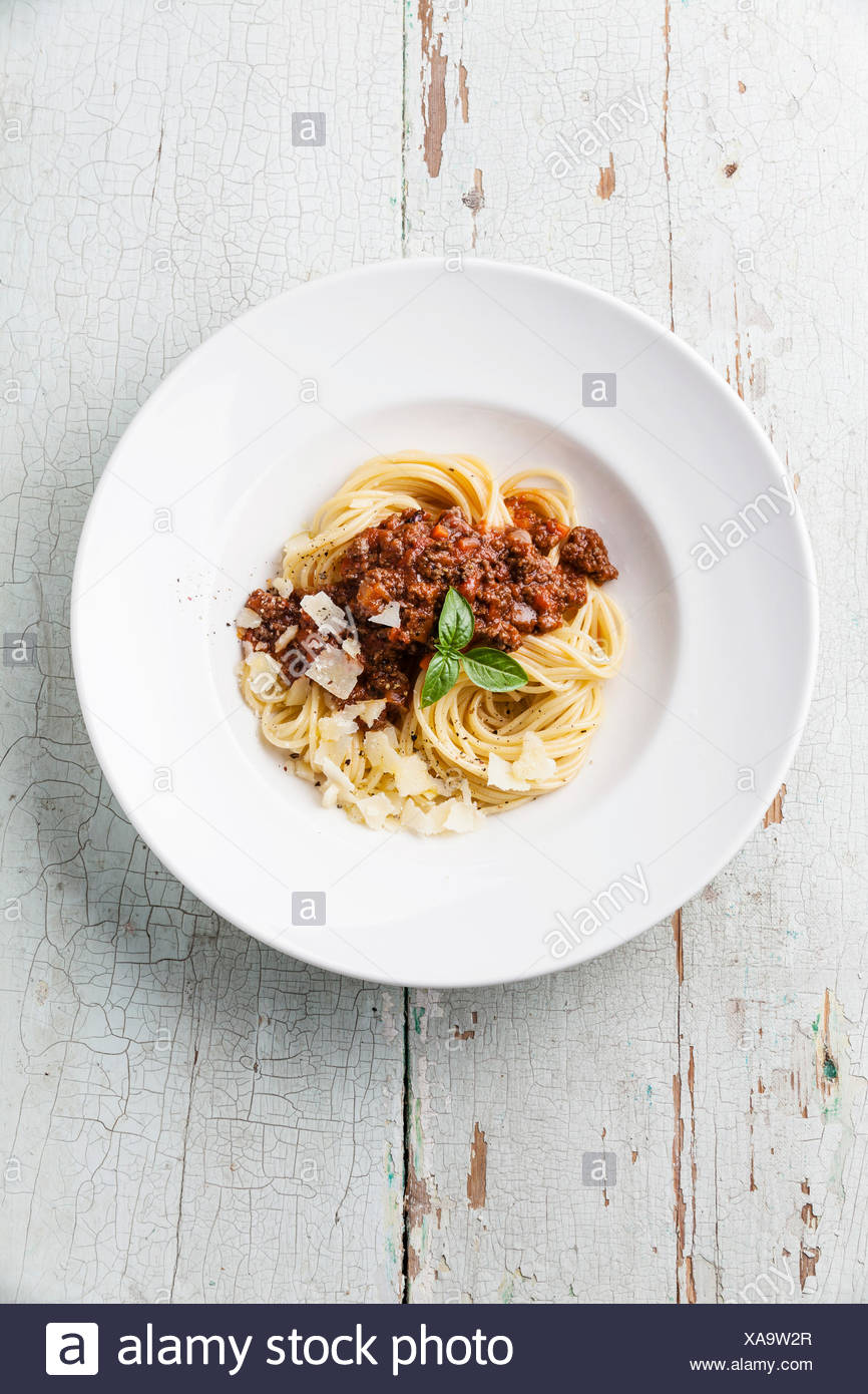 Spaghetti Bolognese on blue wooden background - Stock Image