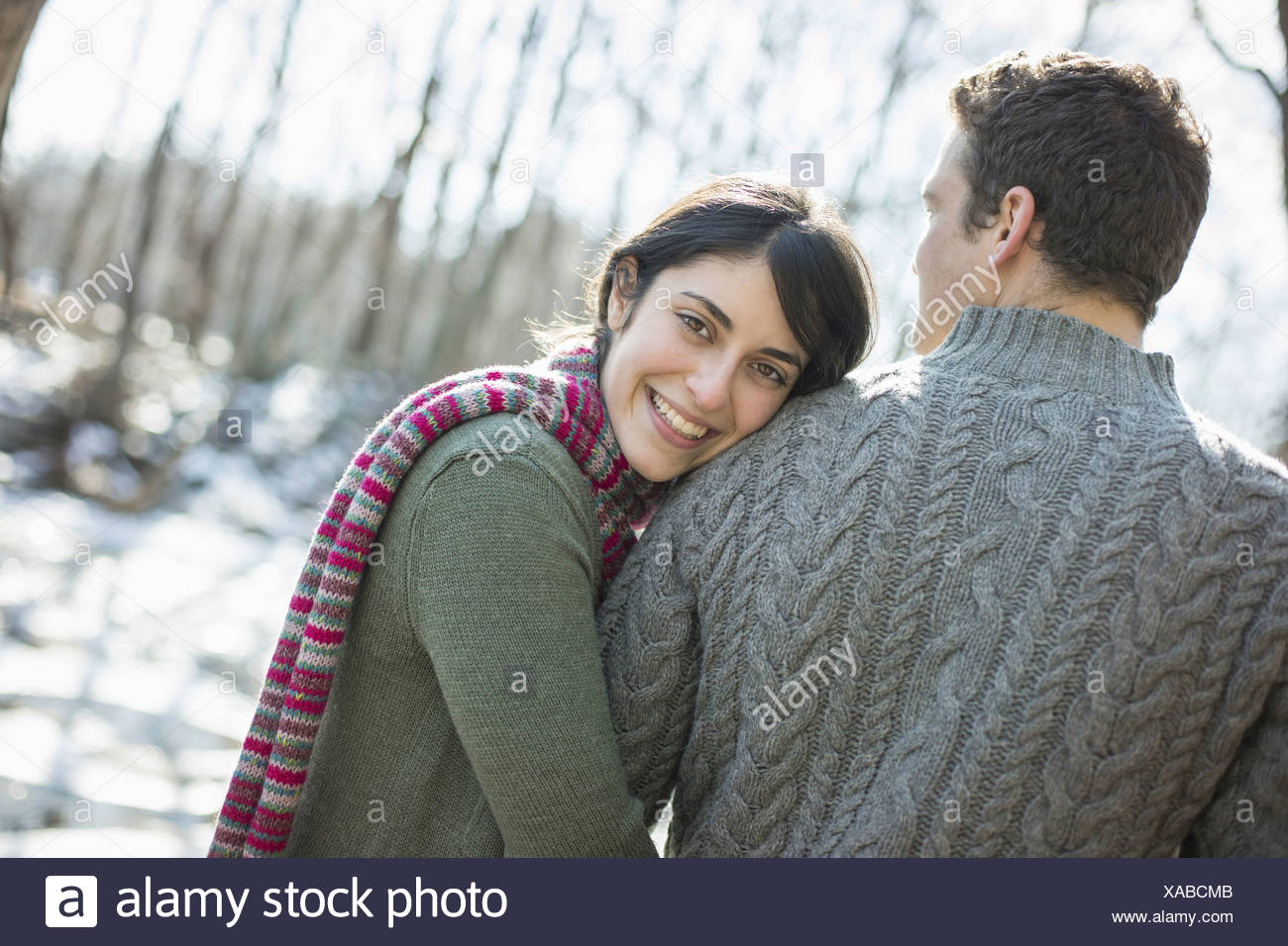 Two people a couple outdoors on a winter day Hugging each other - Stock Image