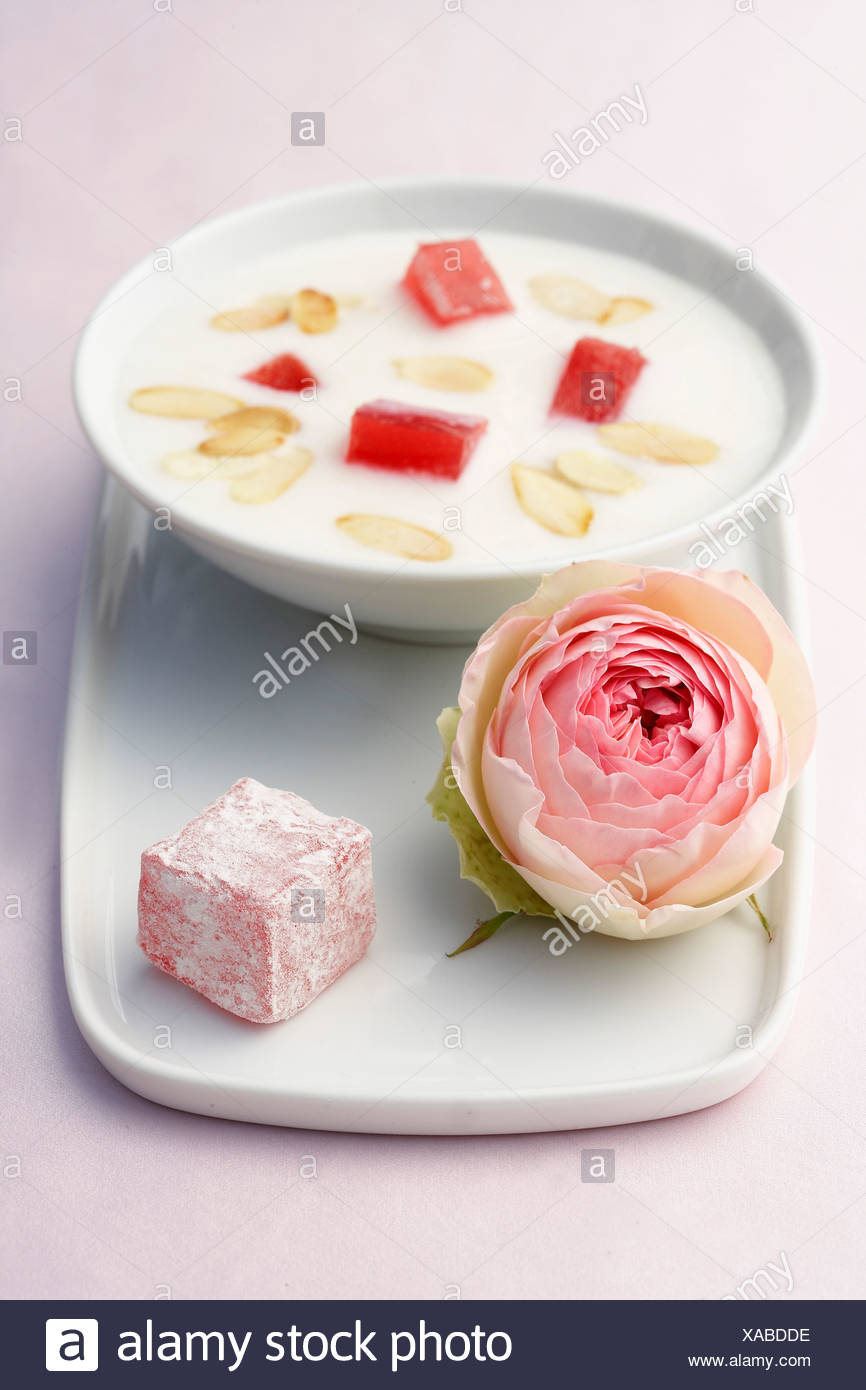 Fermented milk soup with rose-flavored loukoums - Stock Image