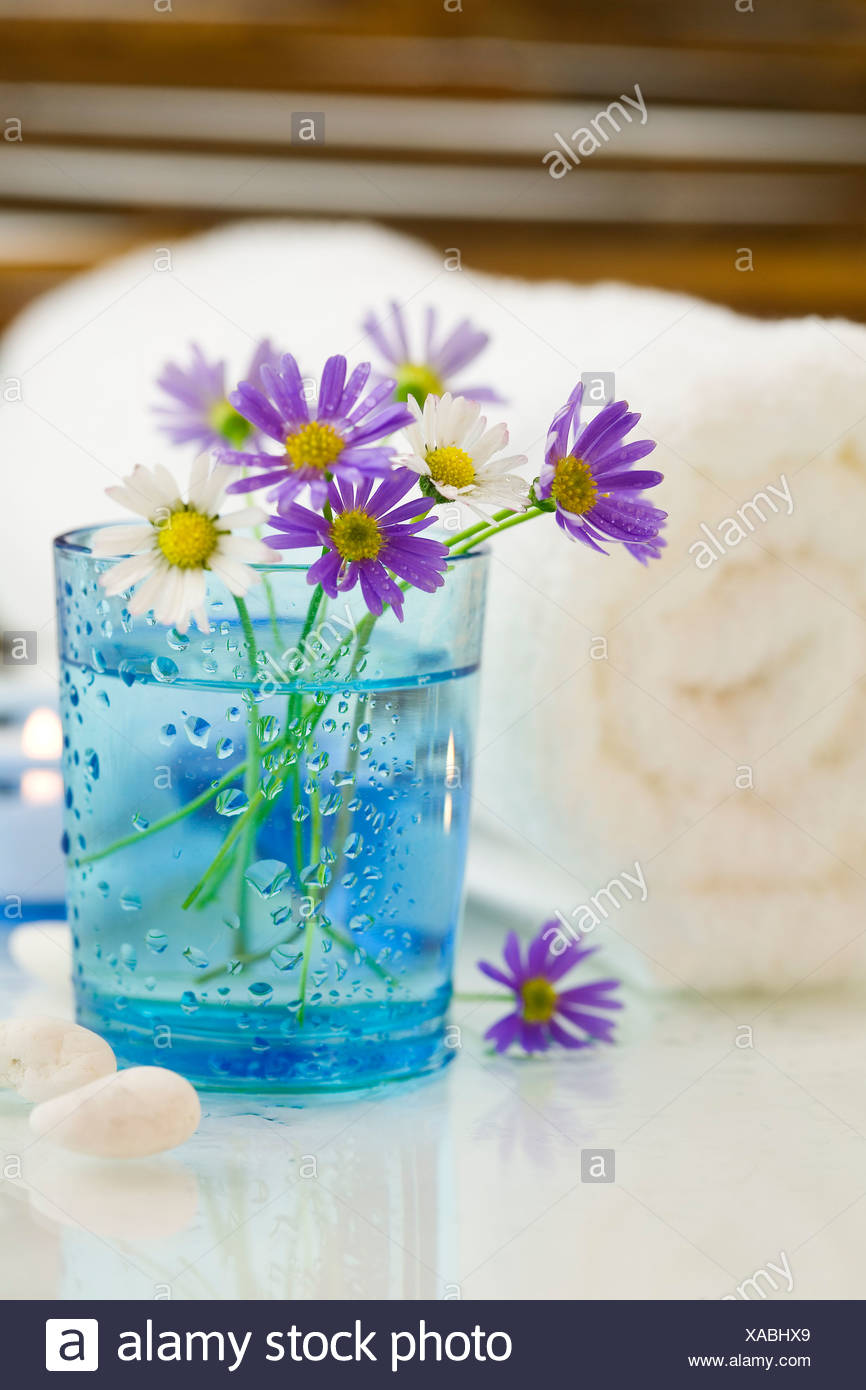 Spa concept (flowers, towel and candles). - Stock Image