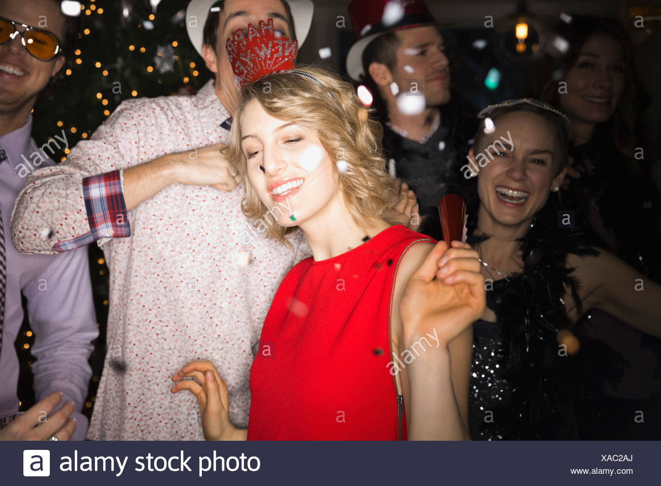 Friends celebrating New Years Eve party - Stock Image