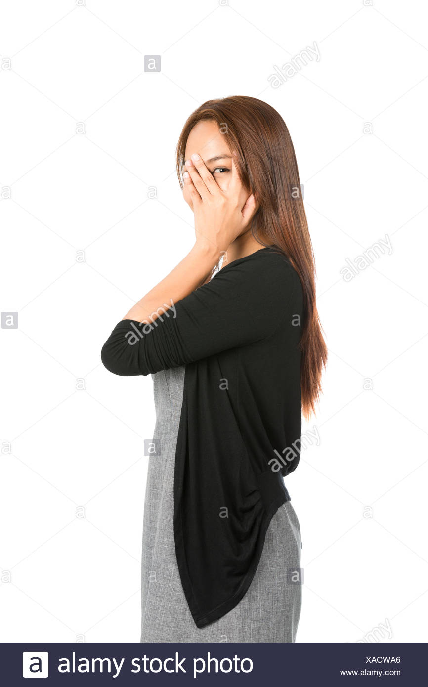 Hand Covering Face Eye Peeking Finger Asian Woman - Stock Image
