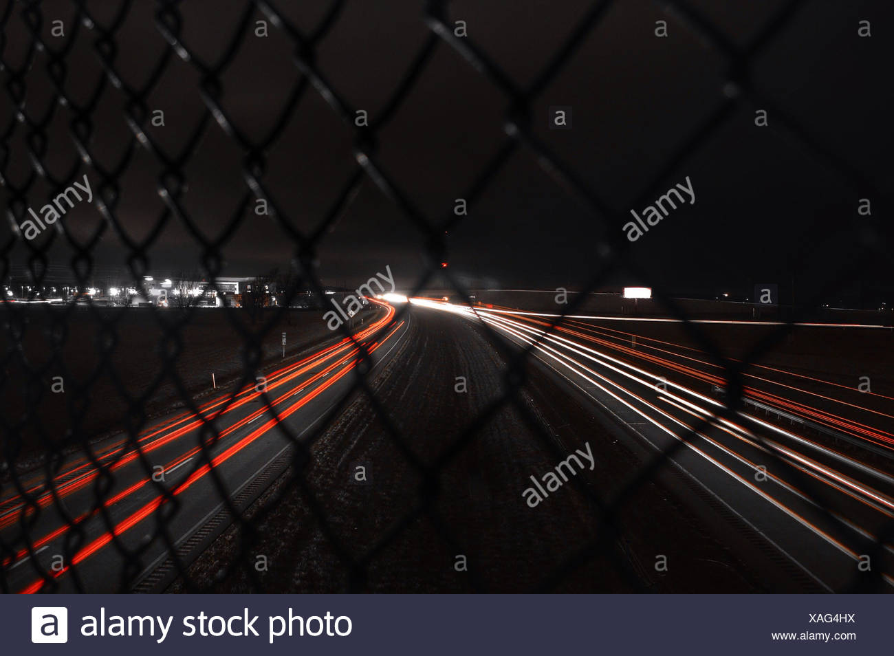 USA, Indiana, Light trails at night - Stock Image