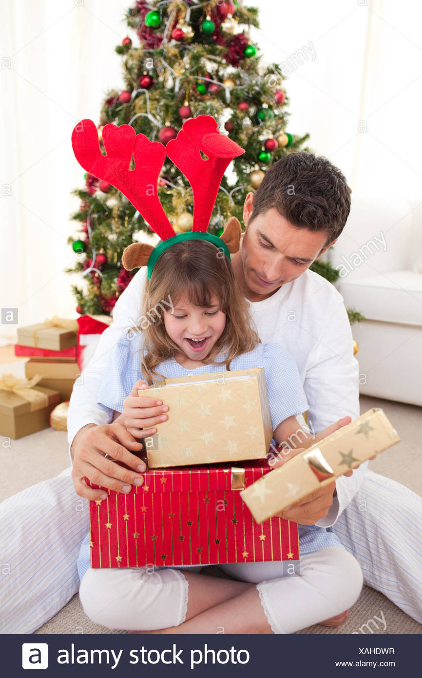 Happy father and his daughter opening Christmas gifts Stock Photo ...