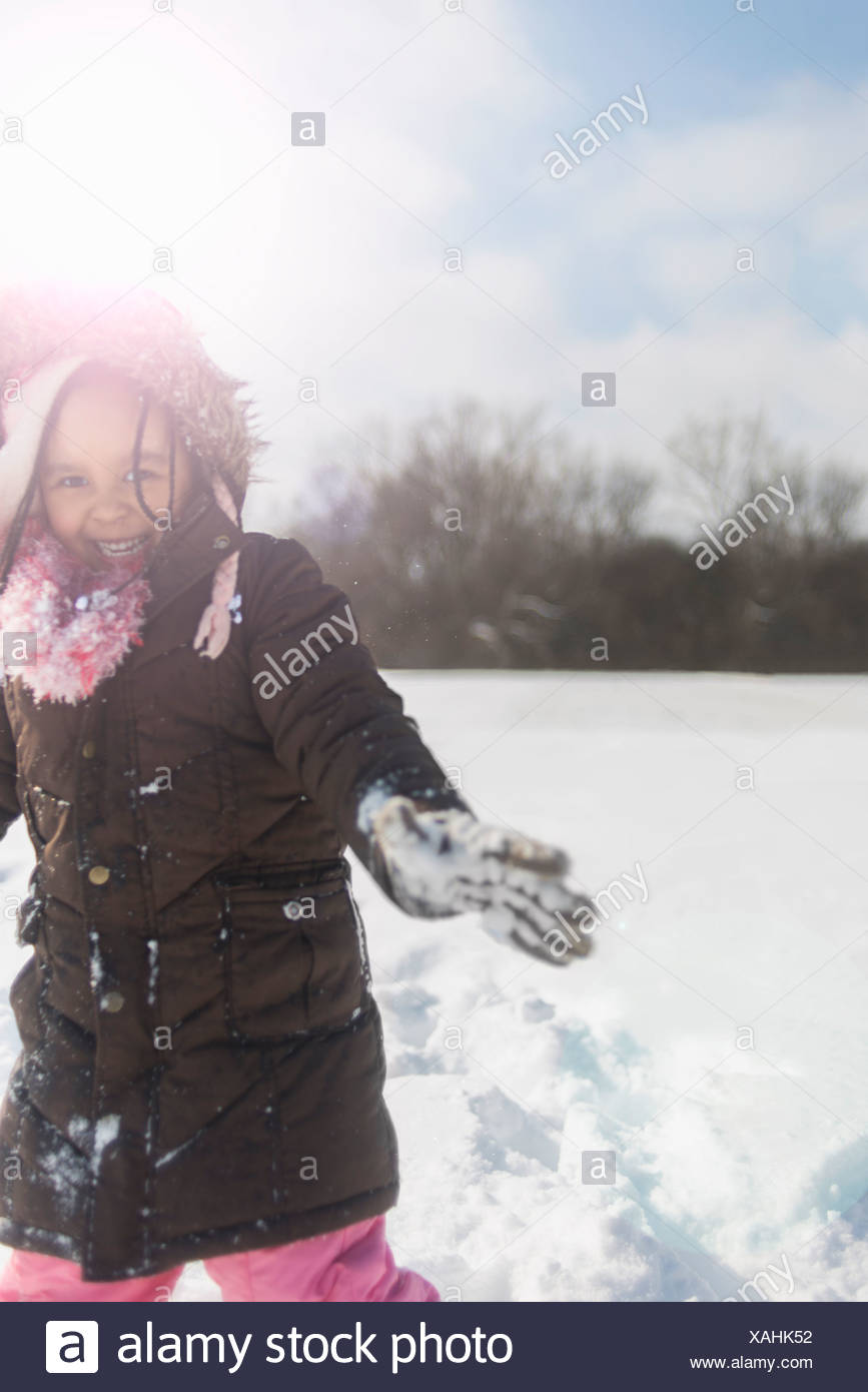 Young girl having fun in deep snow - Stock Image