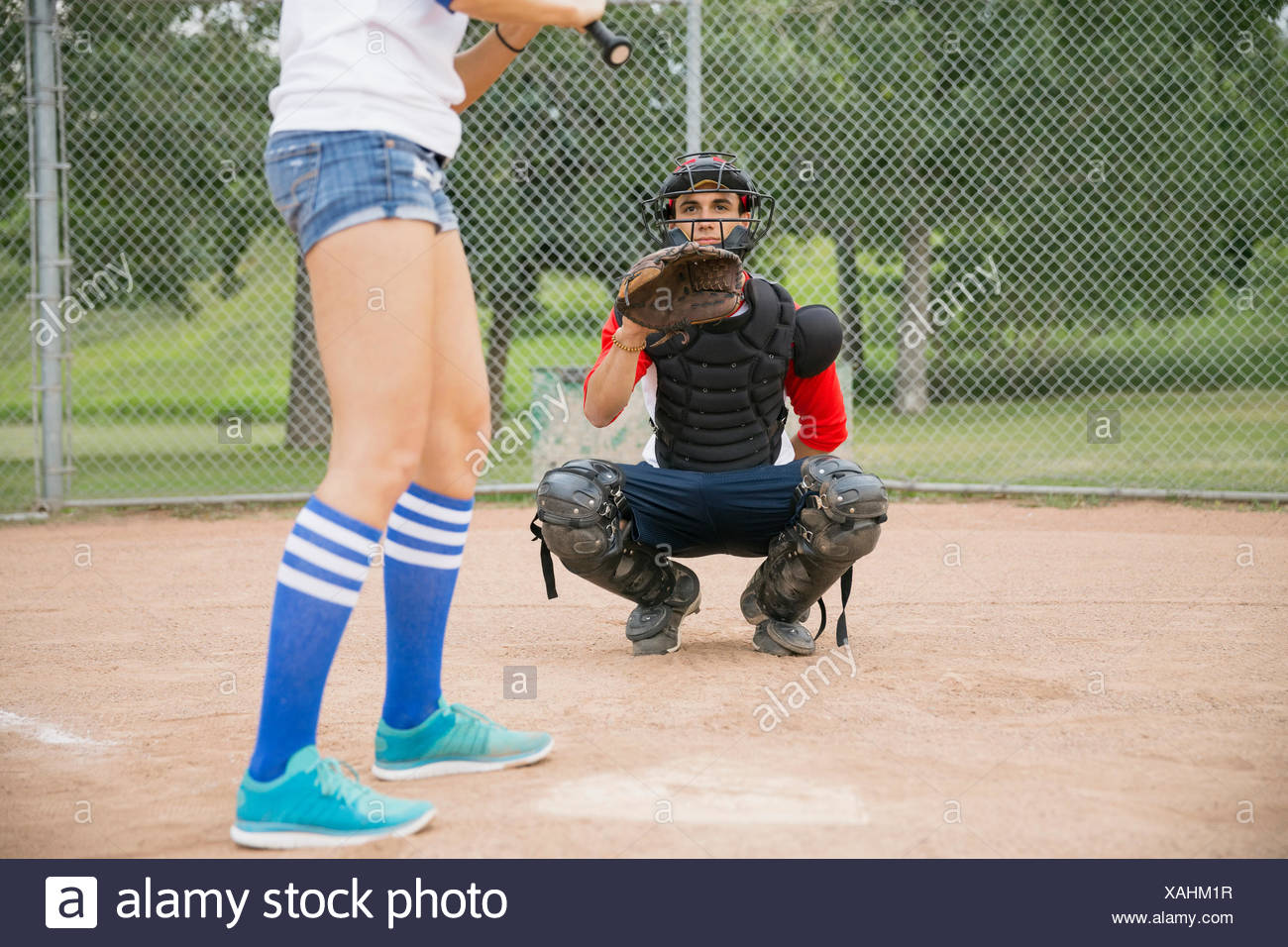 Catcher ready for ball at home plate - Stock Image