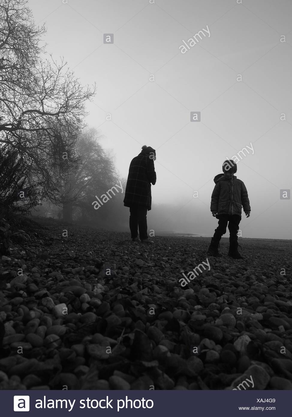 Children On Field During Foggy Weather - Stock Image