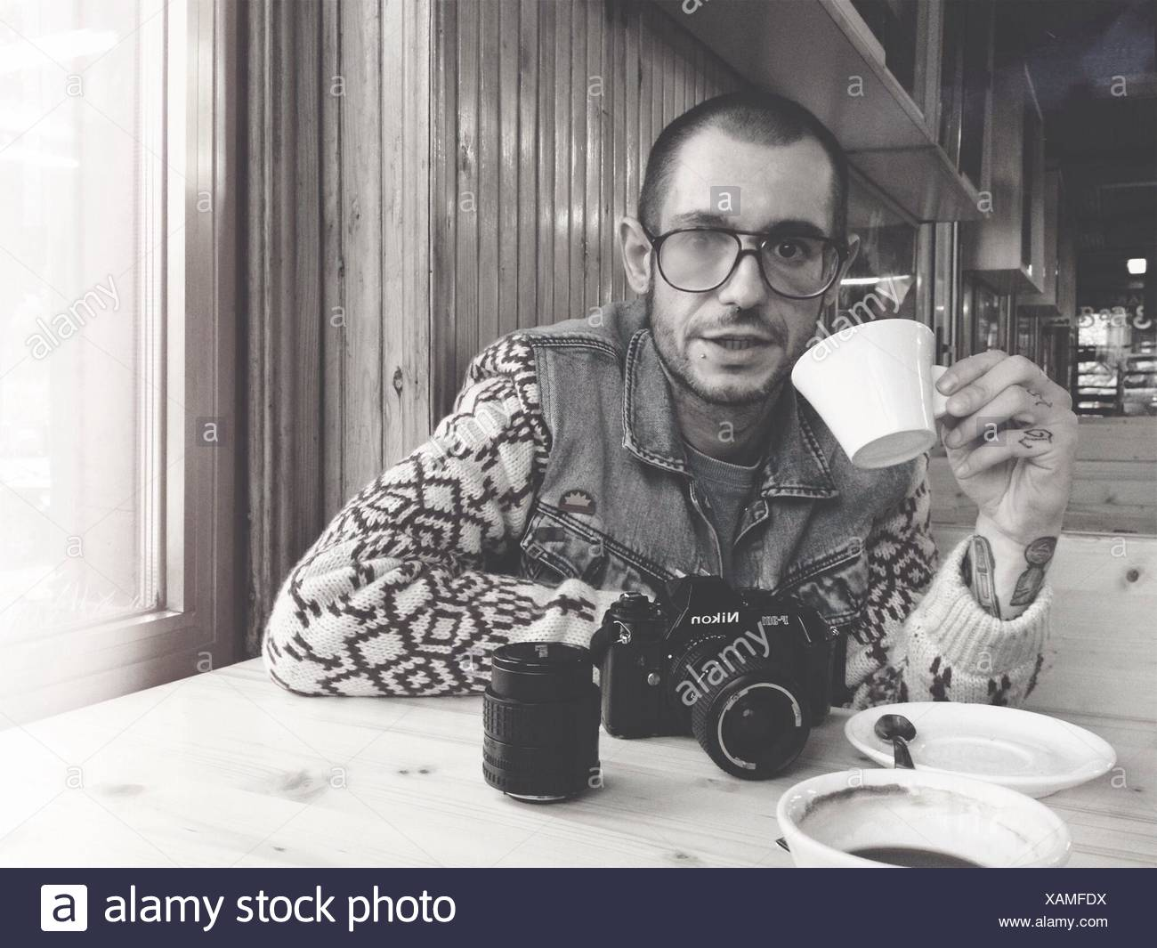 Portrait Of A Young Man Drinking Tea - Stock Image