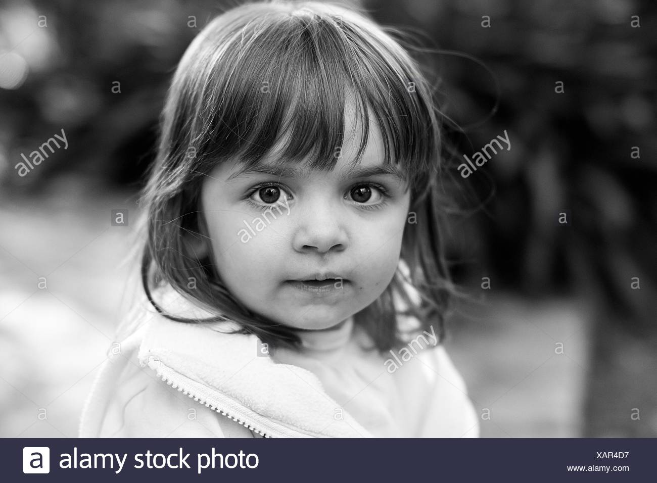 Argentina, Buenos Aires, Portrait of girl (2-3) looking at camera - Stock Image