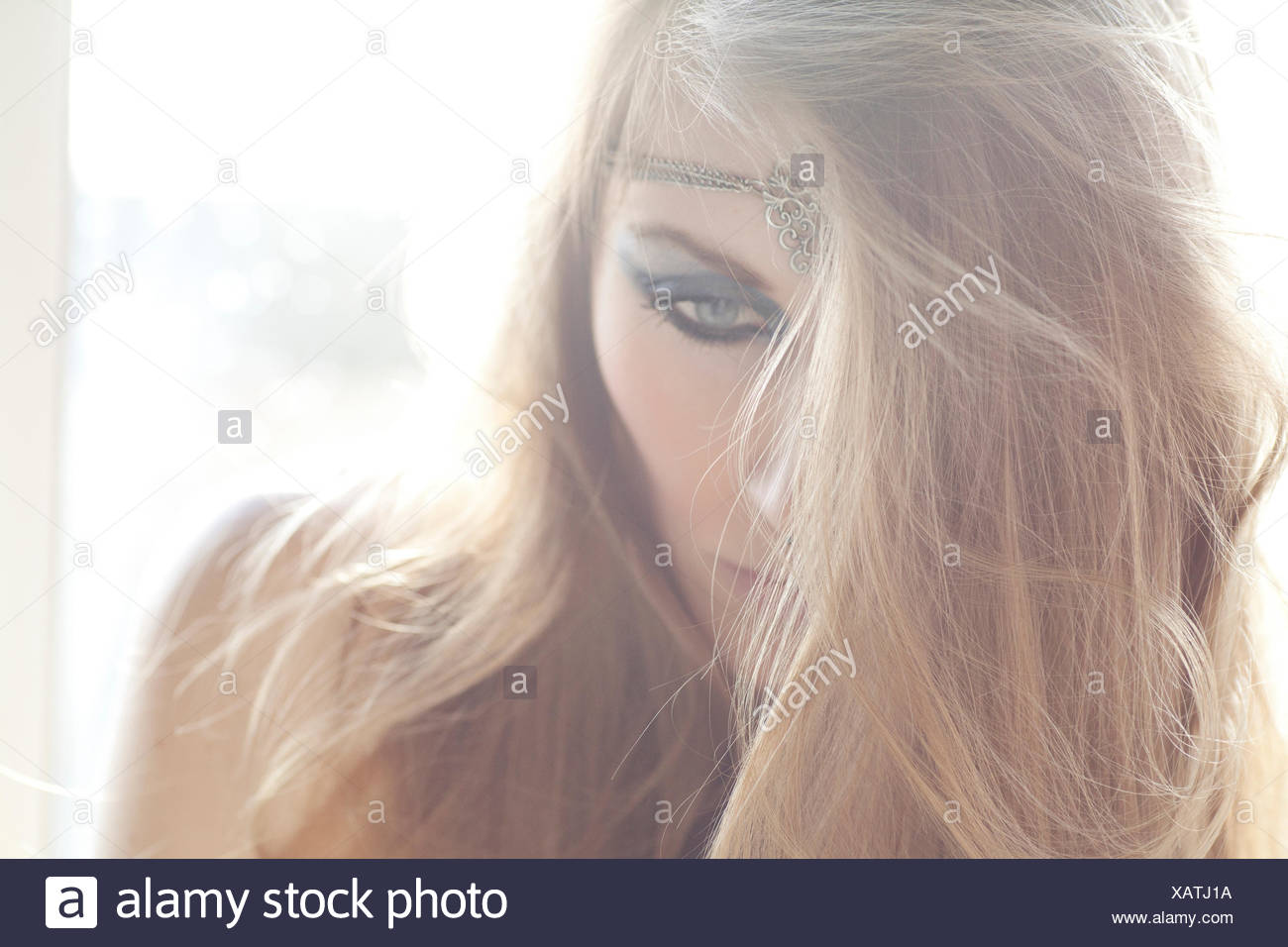 Portrait of a young woman, downcast look - Stock Image