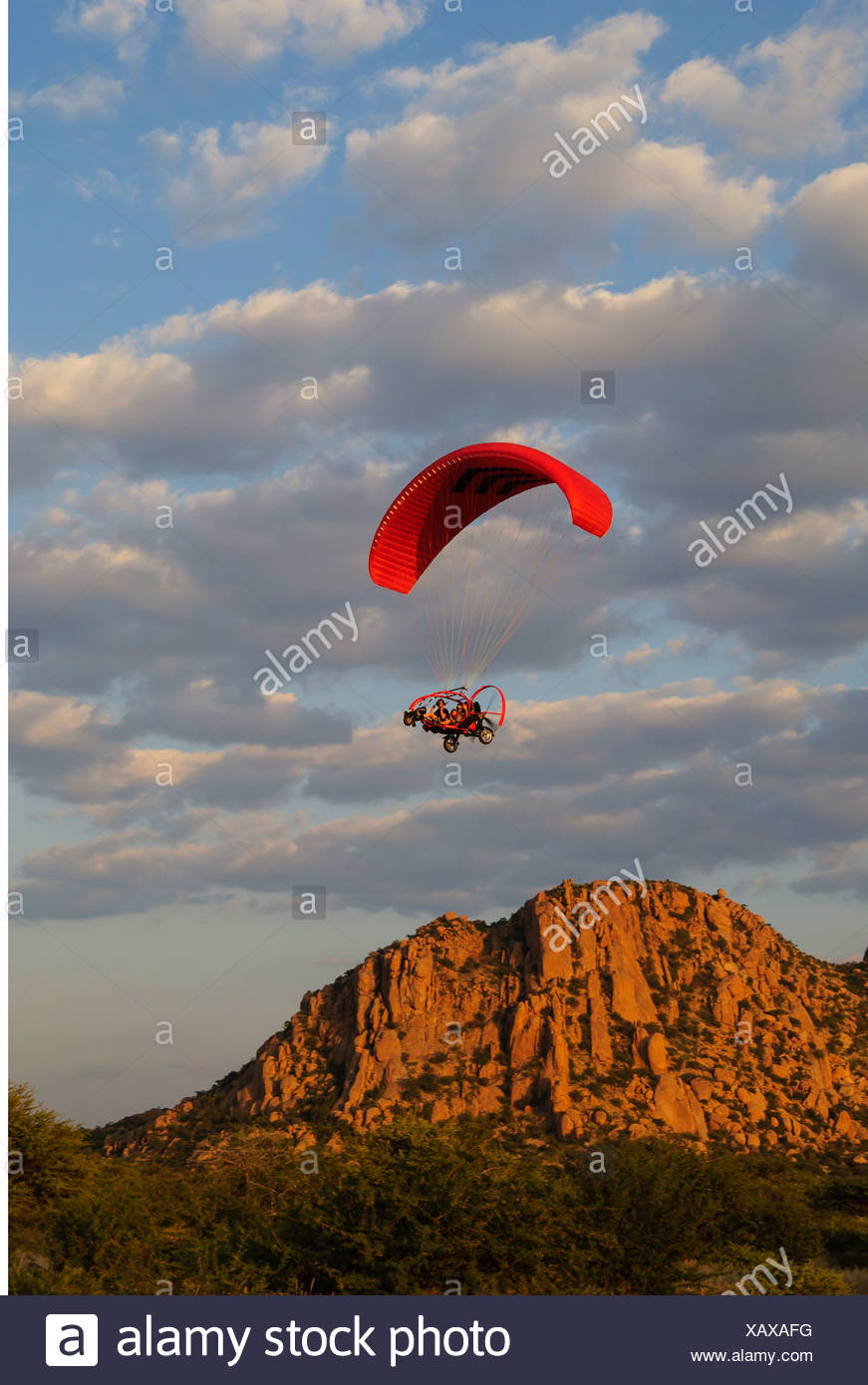sports paragliding paraglider Xcitor 2009 motor-driven paraglide Erongo Namibia Southern Africa mounts mount flying flight - Stock Image