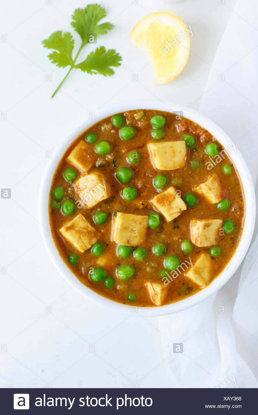 Paneer Mutter , Indian Food , India Cottage cheese and Peas immersed in an Onion Tomato Gravy - Stock Image