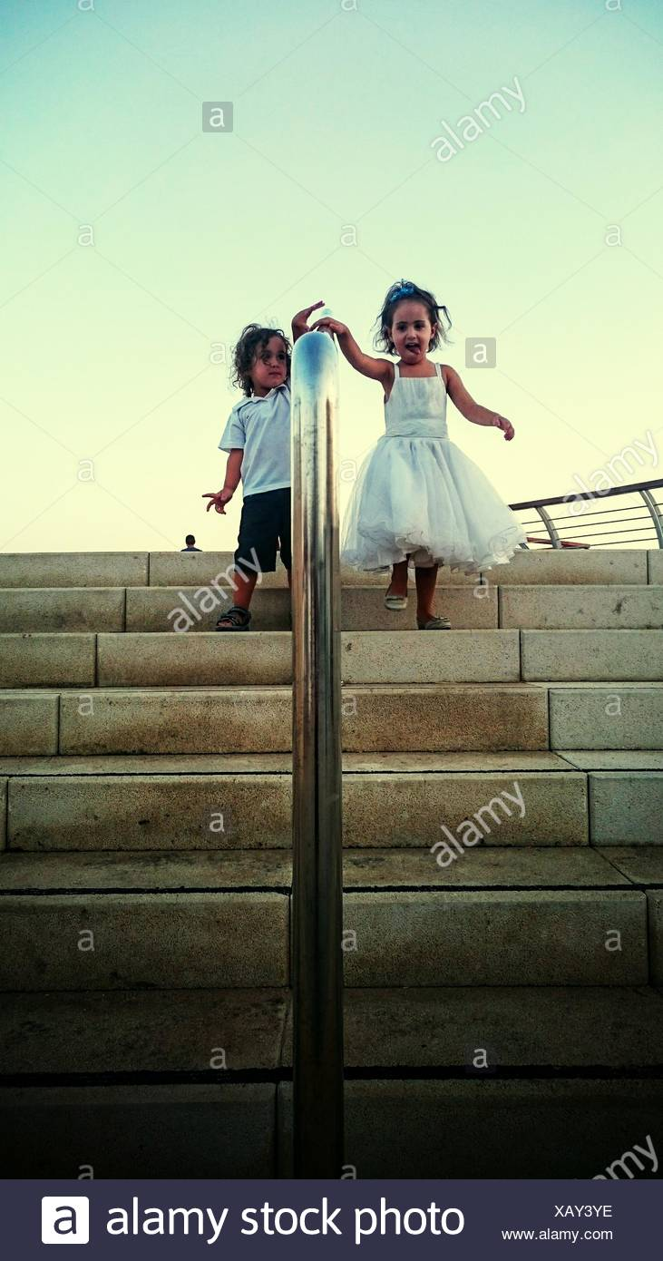 Kids Walking Down Stairs - Stock Image