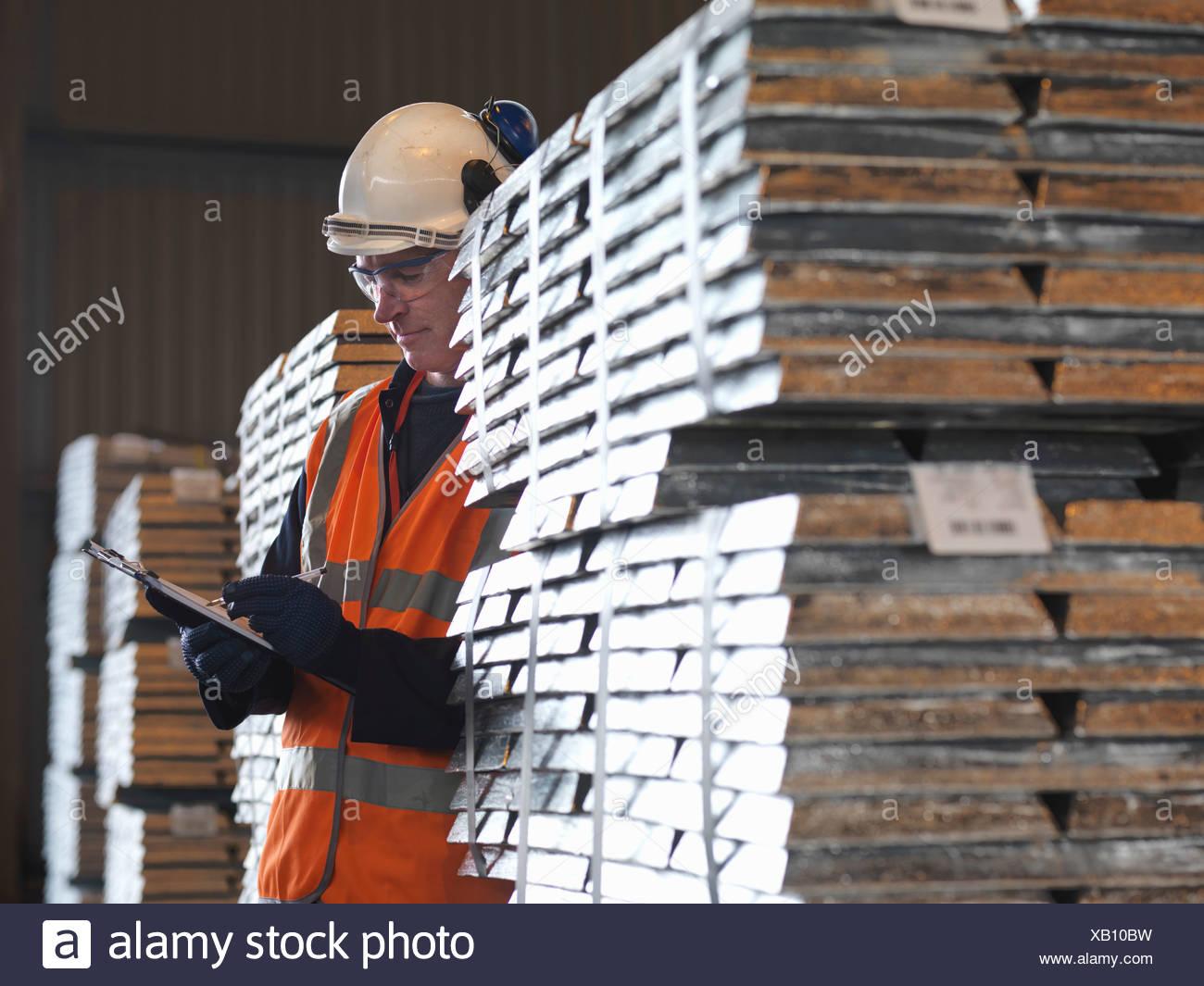 Port Worker Inspecting Cargo - Stock Image
