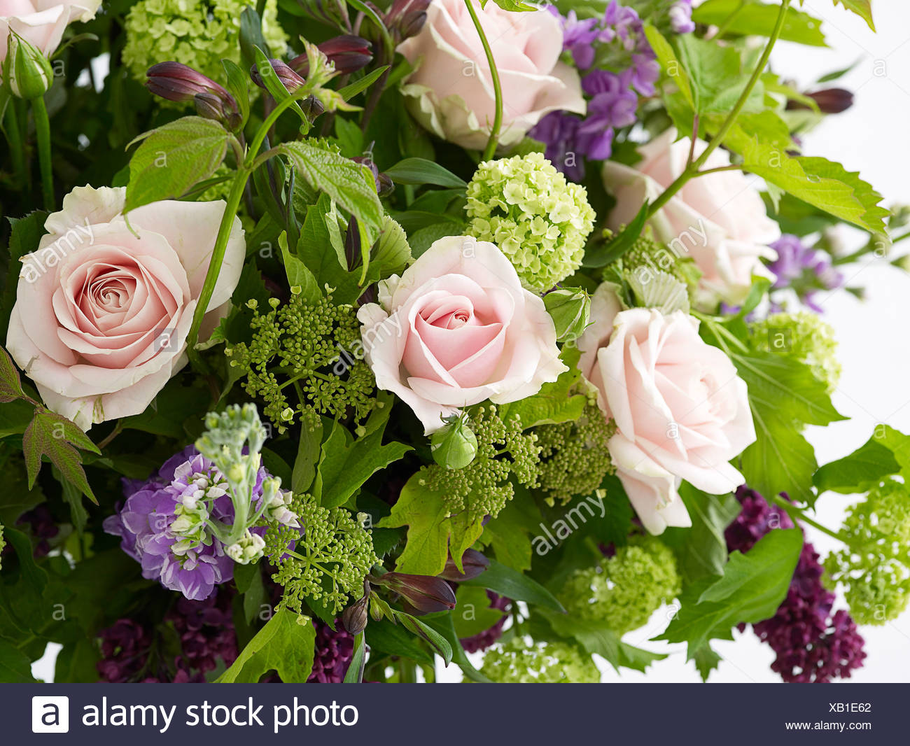 Bunch Of Flowers Including Pink Roses Stocks Lilacs Guelder And