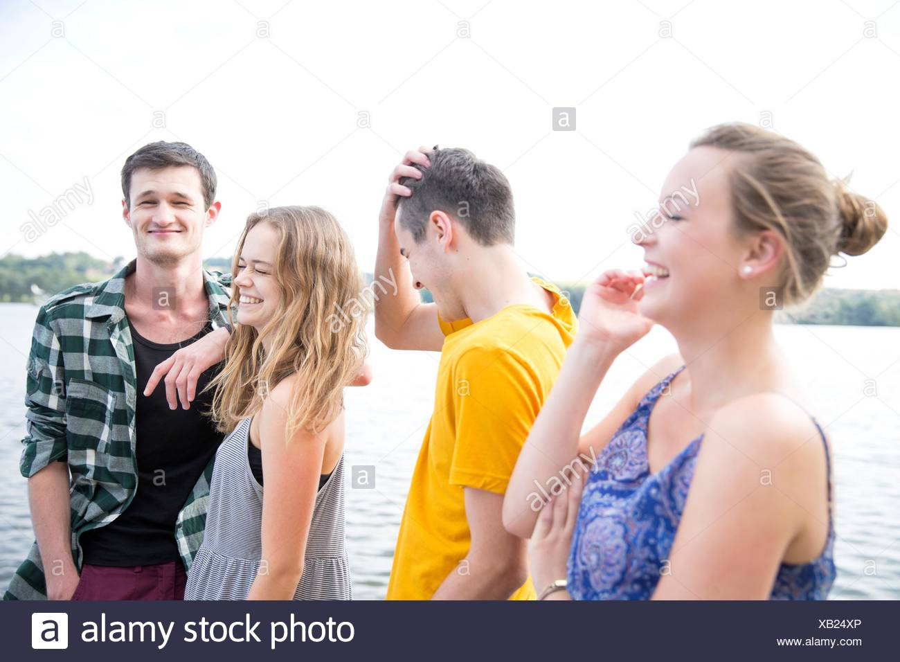 Group of young adults, outdoors, laughing - Stock Image